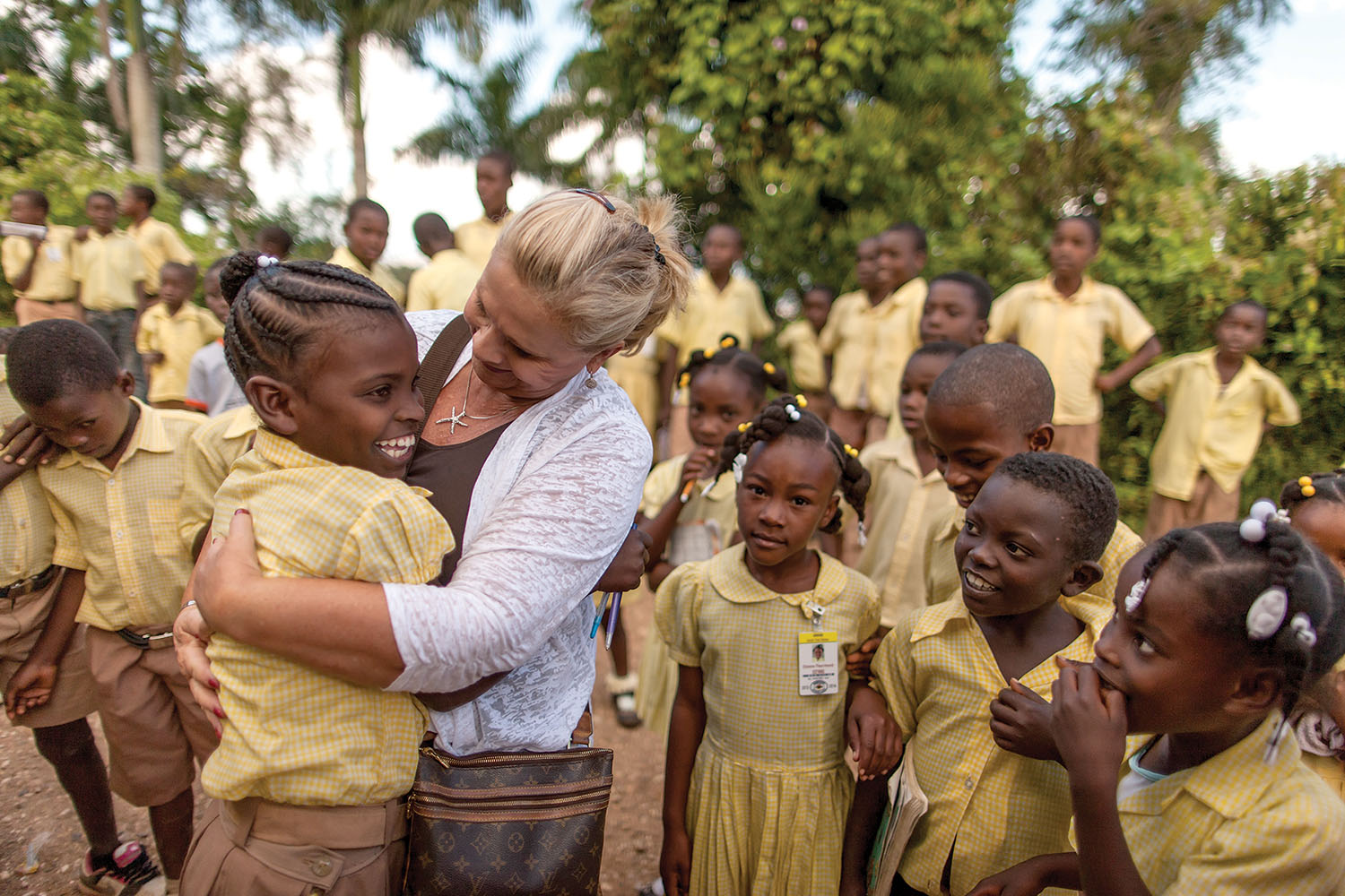 Janet Hunt and her sponsored child Rose embrace with joy as they are reunited at our school in Tom Gateau.