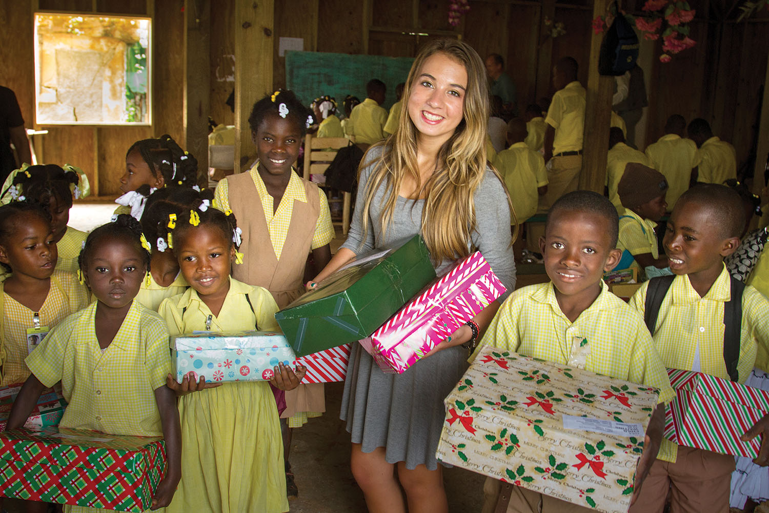 Katie gave gifts to the children knowing each shoebox would bring smiles and hope to a child and their family.