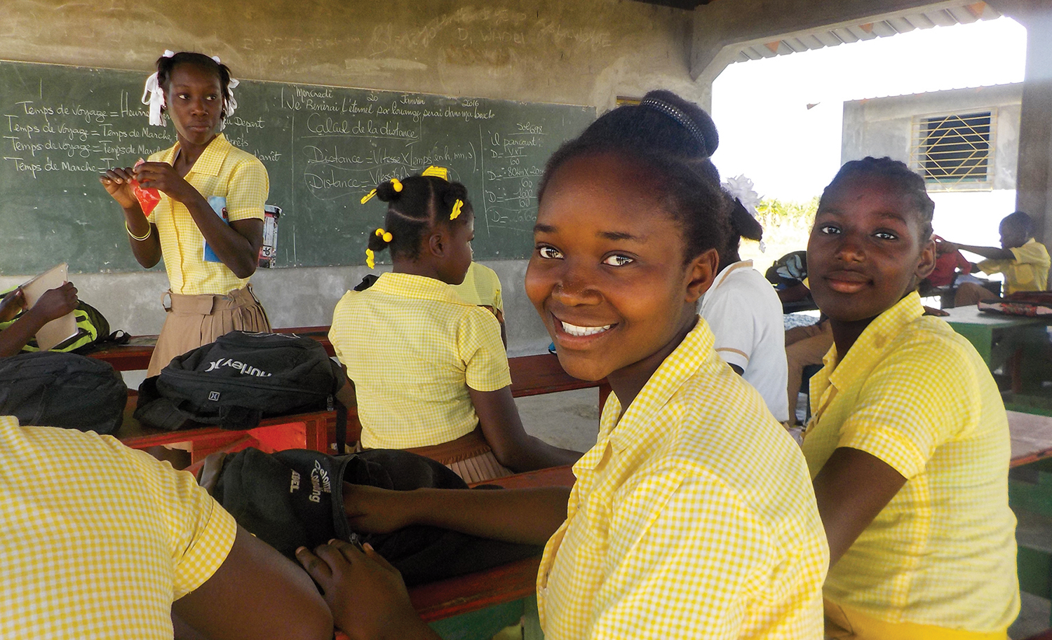 Tamar Calixthe is from the island of La Gonâve and attends school at New Missions in Bord-Mer, as there is no school for her to attend on the island.