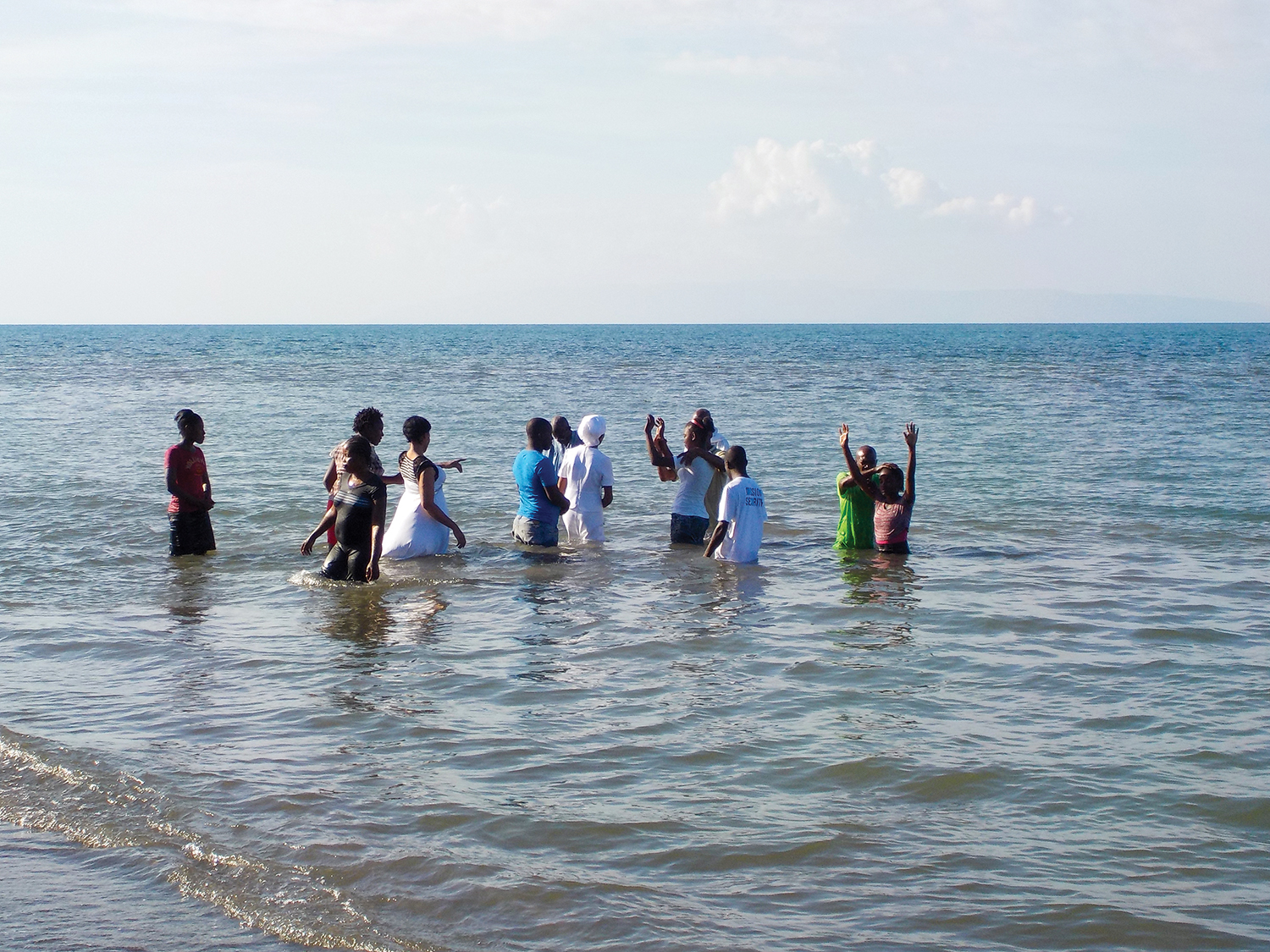We celebrate with the 52 Haitians following in believer's baptism.