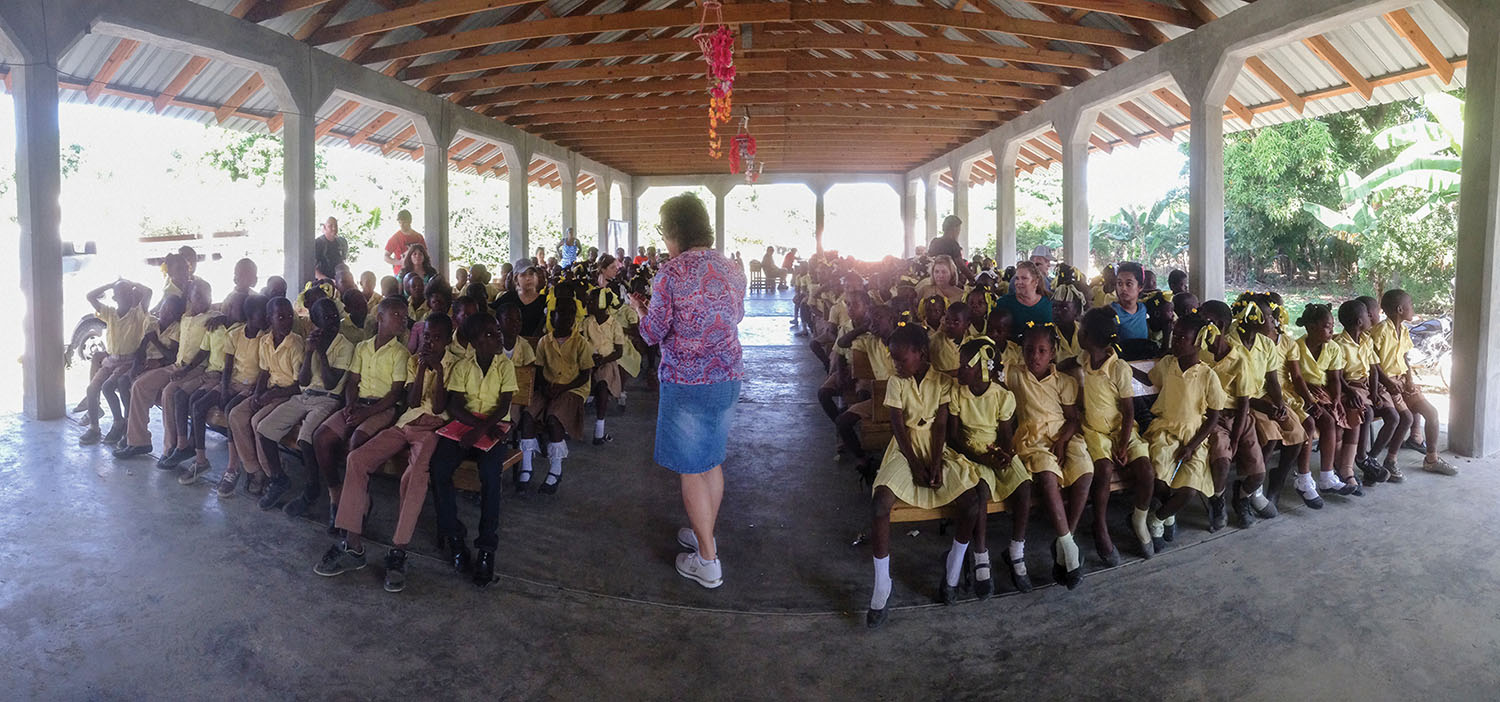 Jeanne DeTellis encouraged our students from Bire, Haiti, prior to receiving their shoebox gifts.
