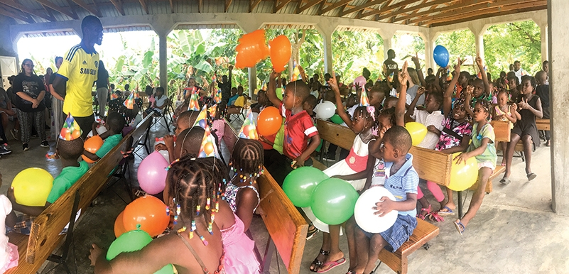 Fifth birthday parties like this one hosted in Lassale, Haiti, bring a smile and hope to these children and their families.