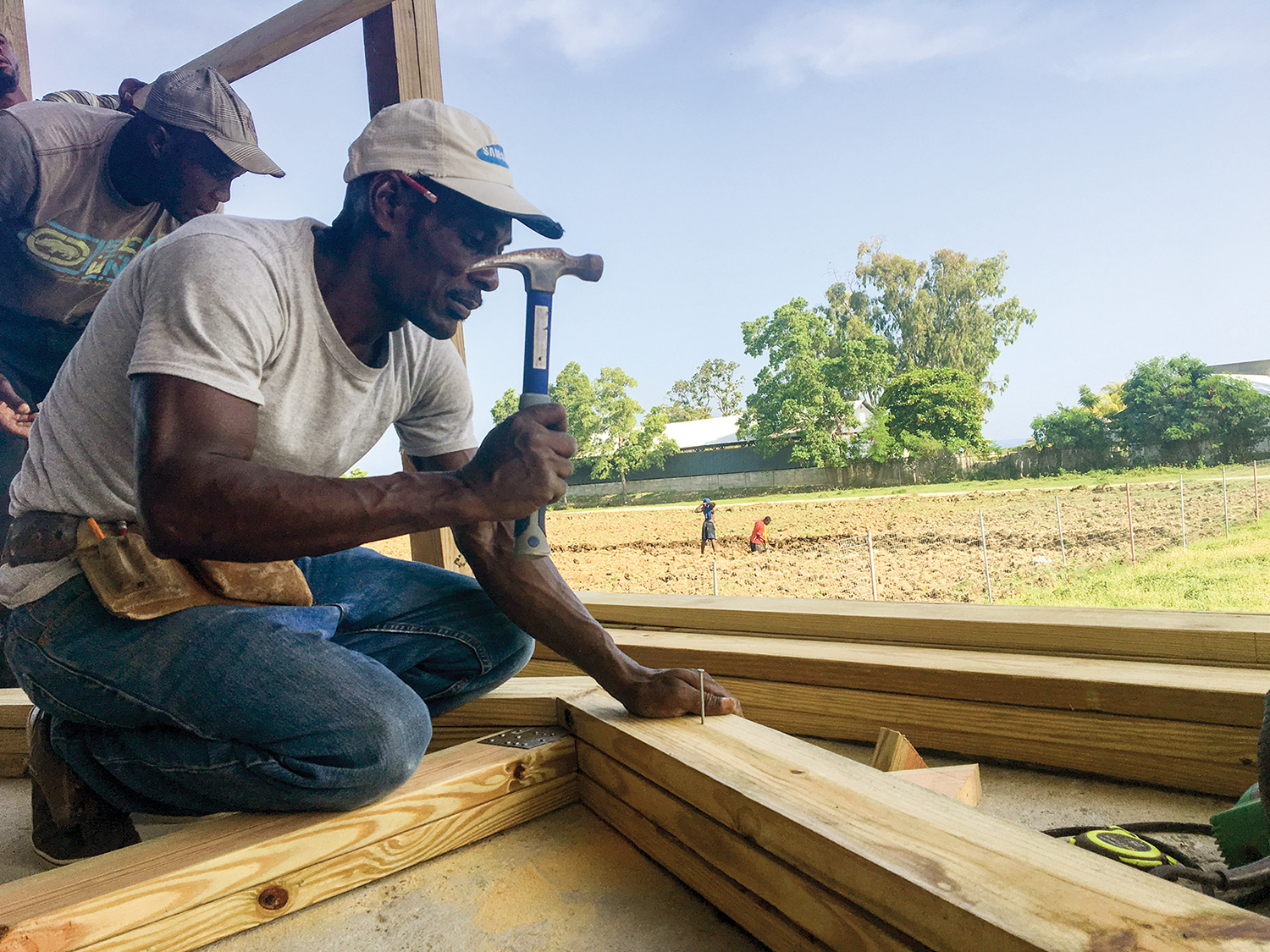 Carpenter Sonny works at New Missions making roofing trusses for our churches.