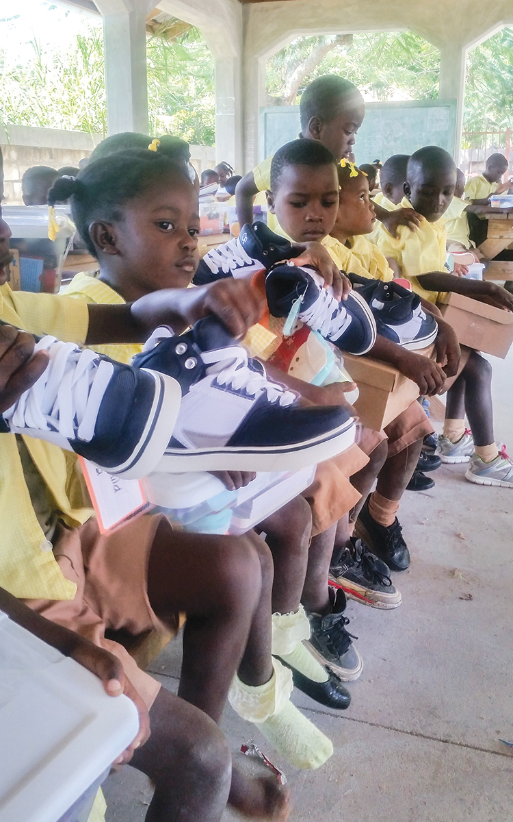 The children of Decouze, Haiti, enjoyed receiving new pairs of sneakers. Get involved at  GiveSneakers.com