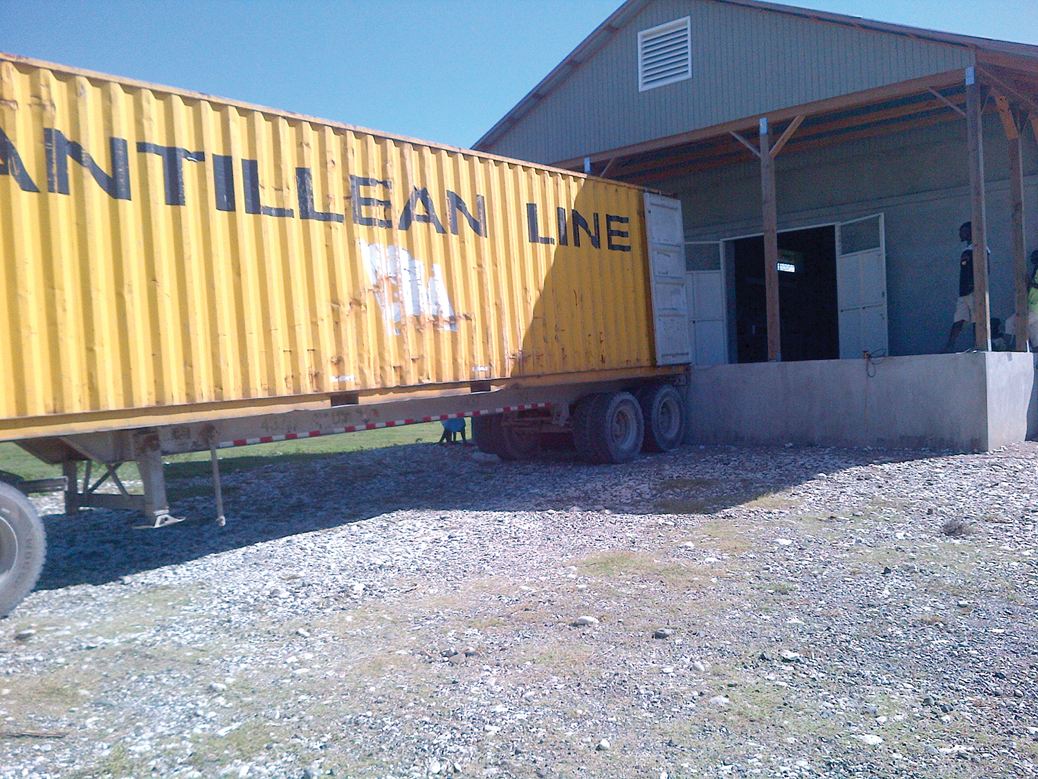 Our warehouse facility in Haiti becomes a happening place as cargo containers arrive with shoeboxes.