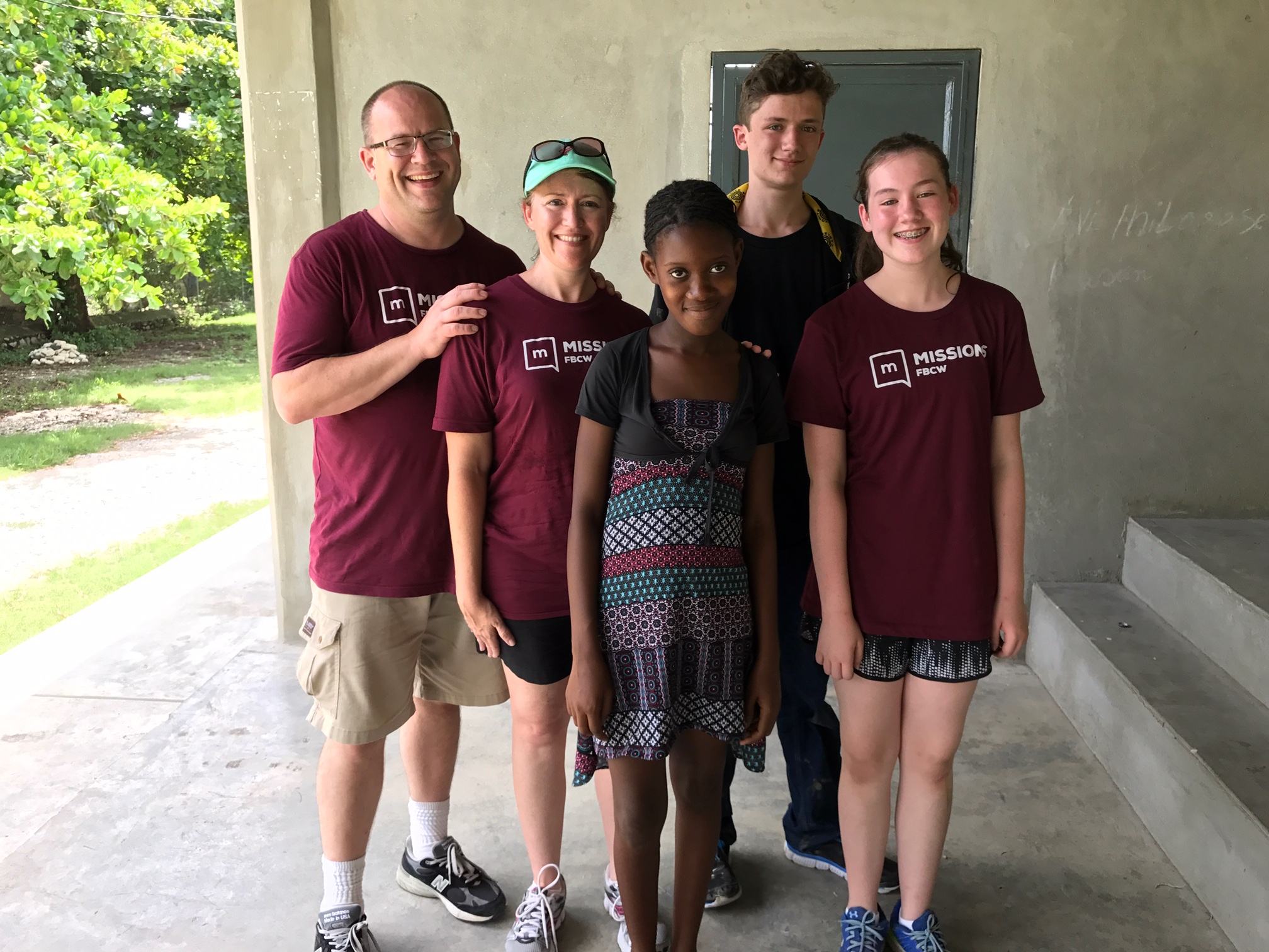 The Taggart family with their sponsor child, Berline.