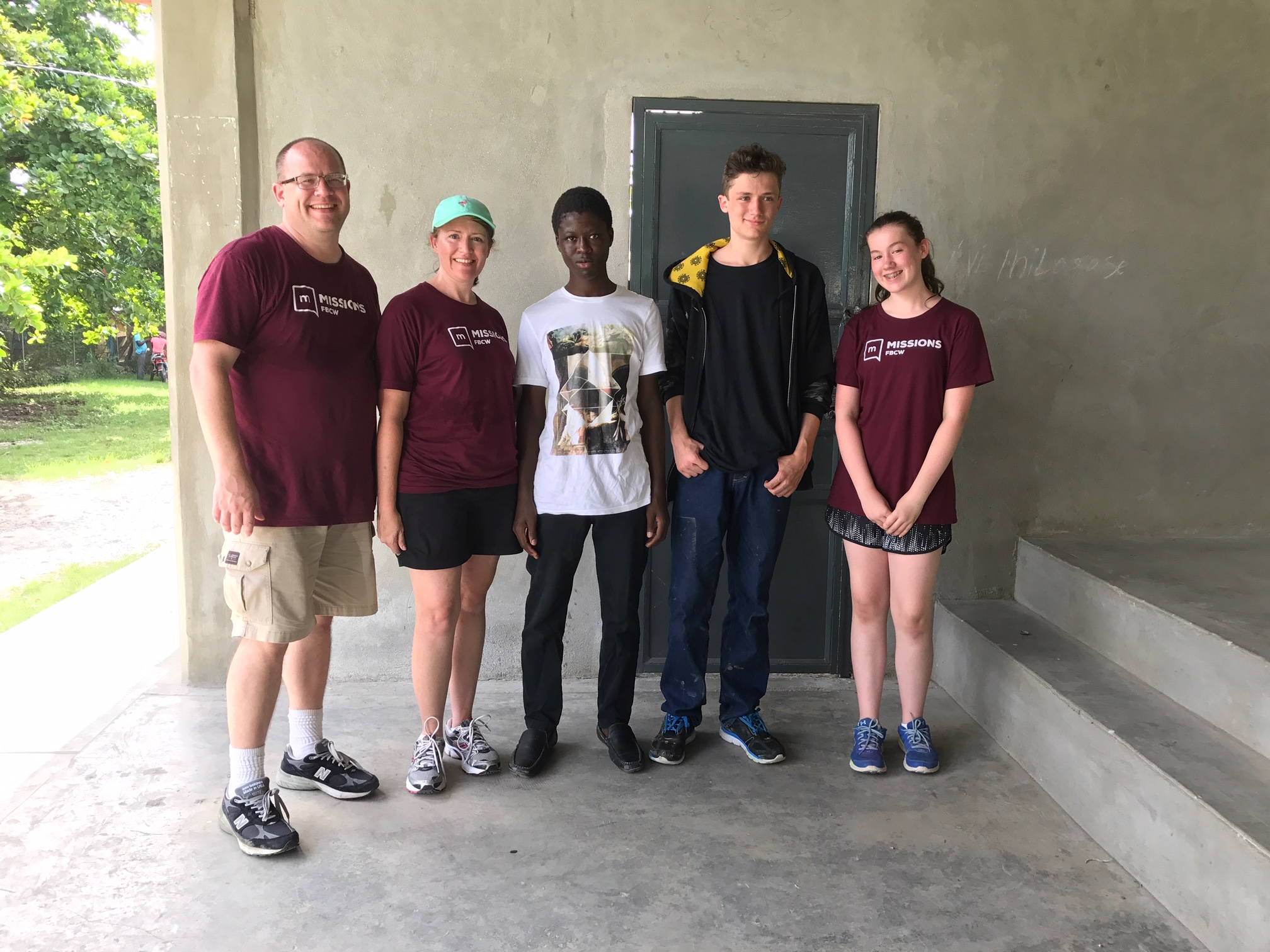 The Taggart family with their sponsor child, Louvenson.