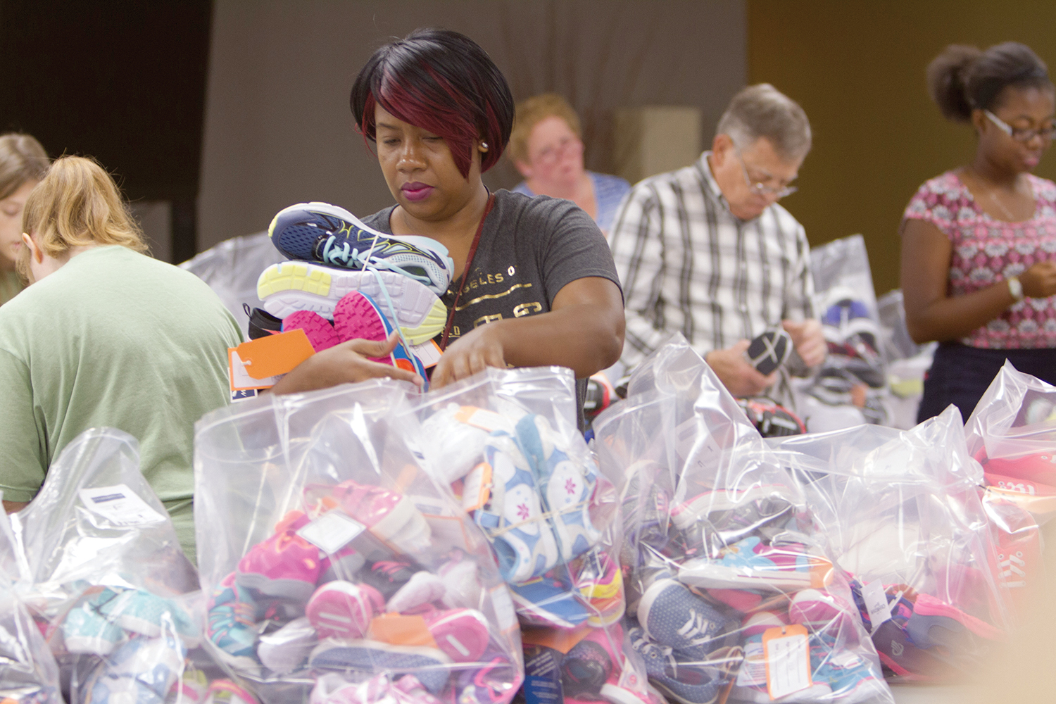 We are thankful for our volunteers who help sort and pack sneakers for Haiti.
