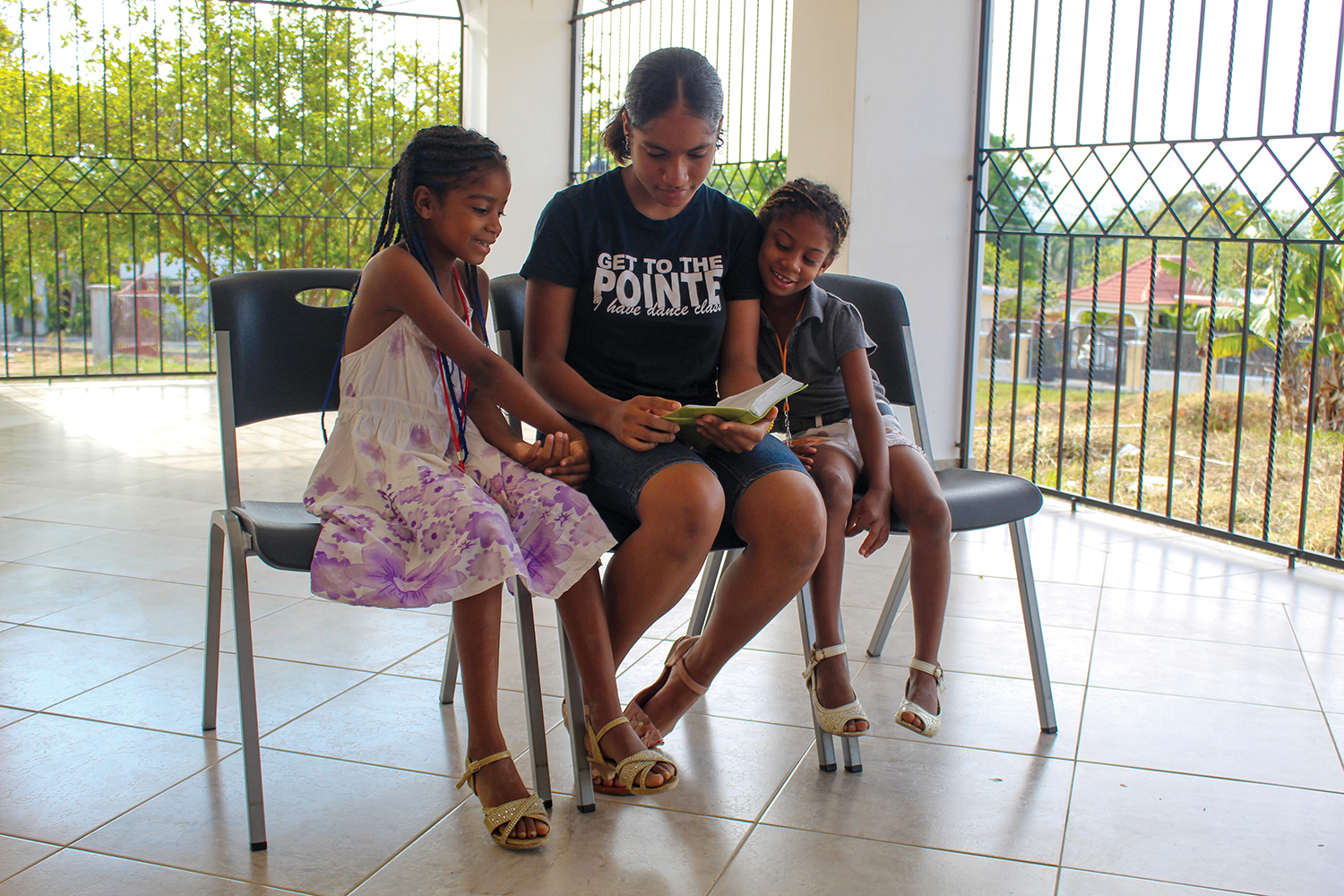 Laira Padilla sits with sisters Yoselin and Yocairy Rosa Nolasco every Saturday and helps them memorize their Bible verses.