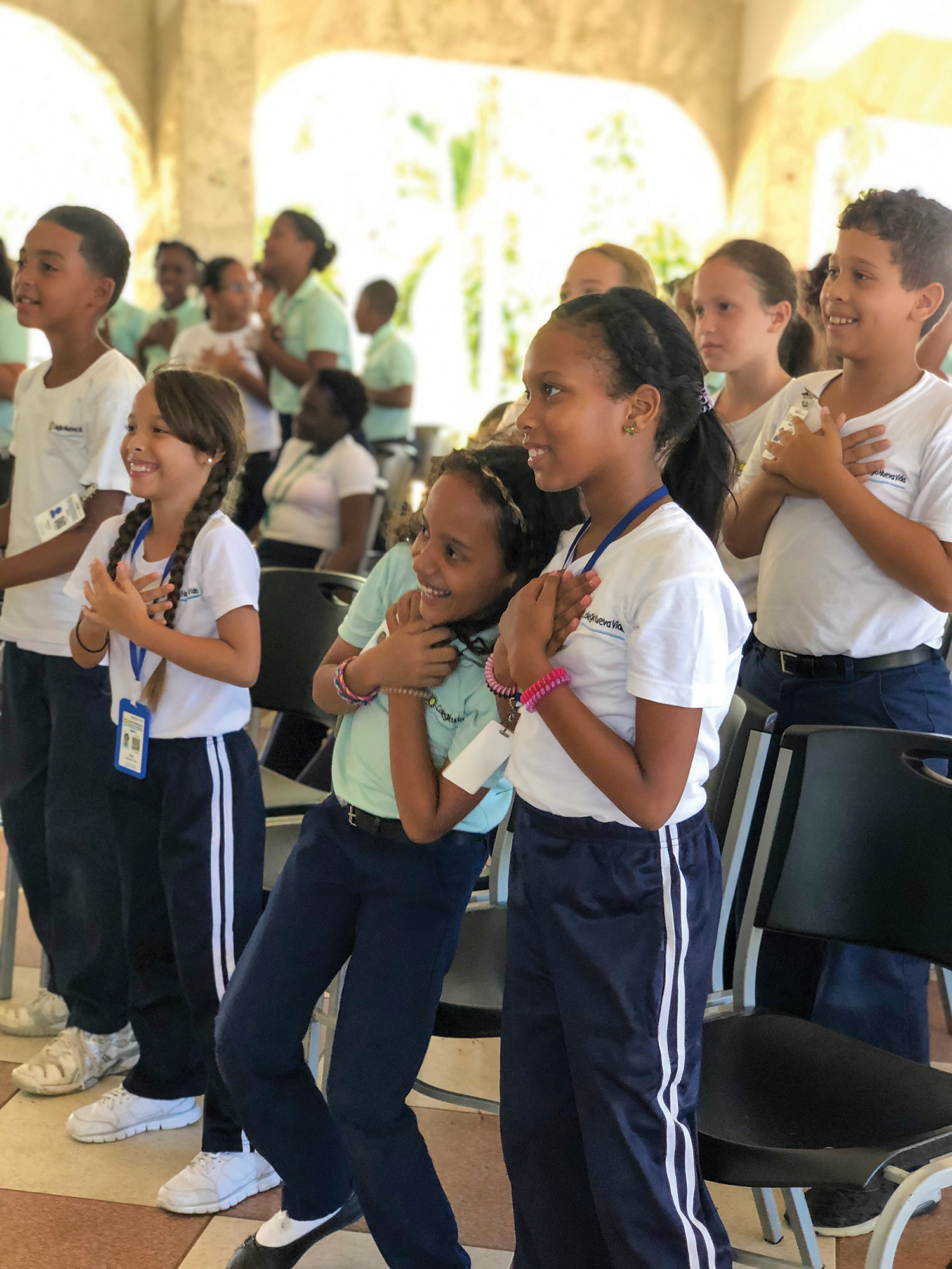 The children love lifting their voices and worshipping God with praise and worship songs during VBS.