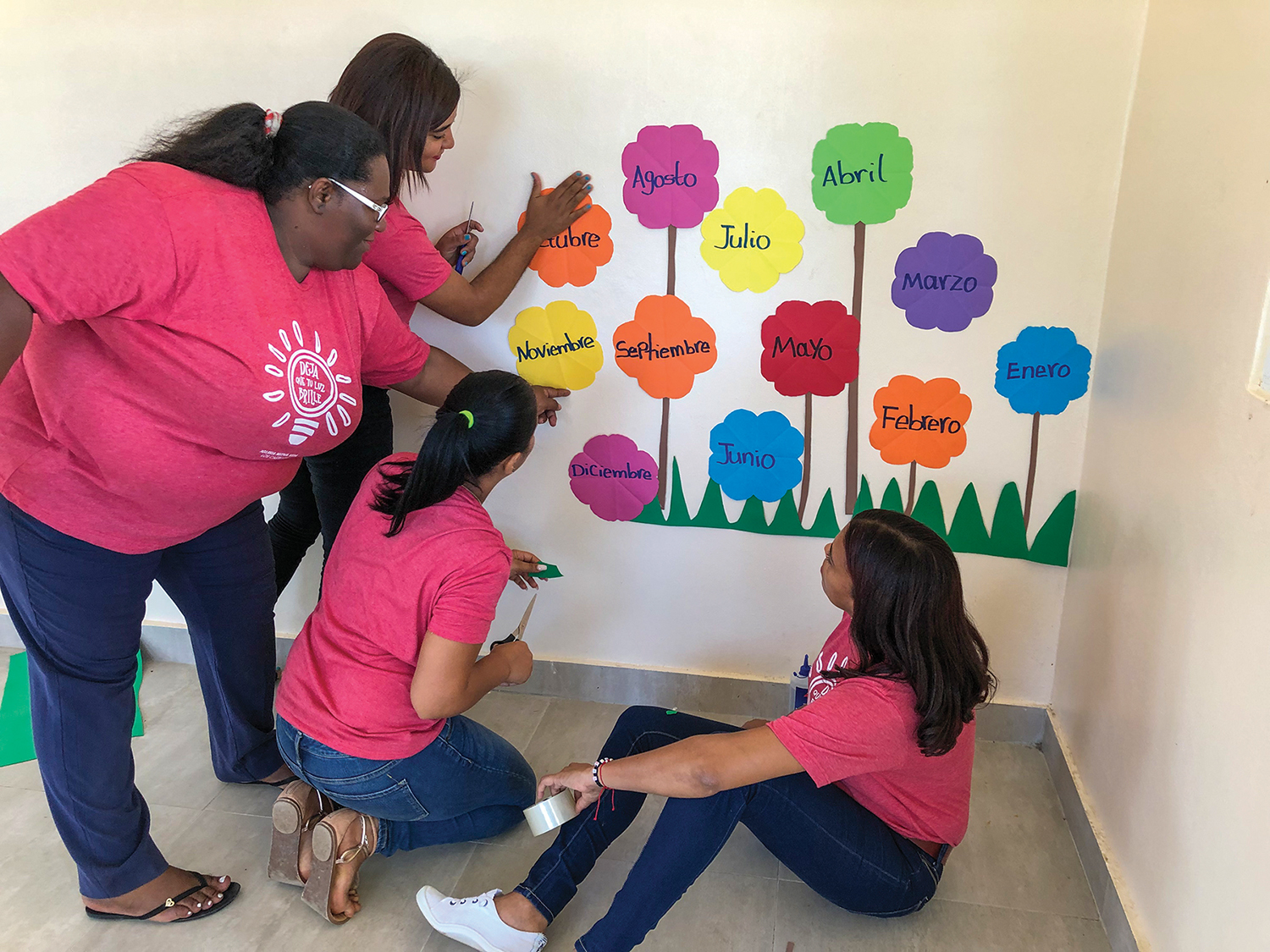 The teachers are putting up a mural with the months of the year in one of the preschool classrooms. Our students, teachers, and directors are so excited and happy for classes to begin later this month.