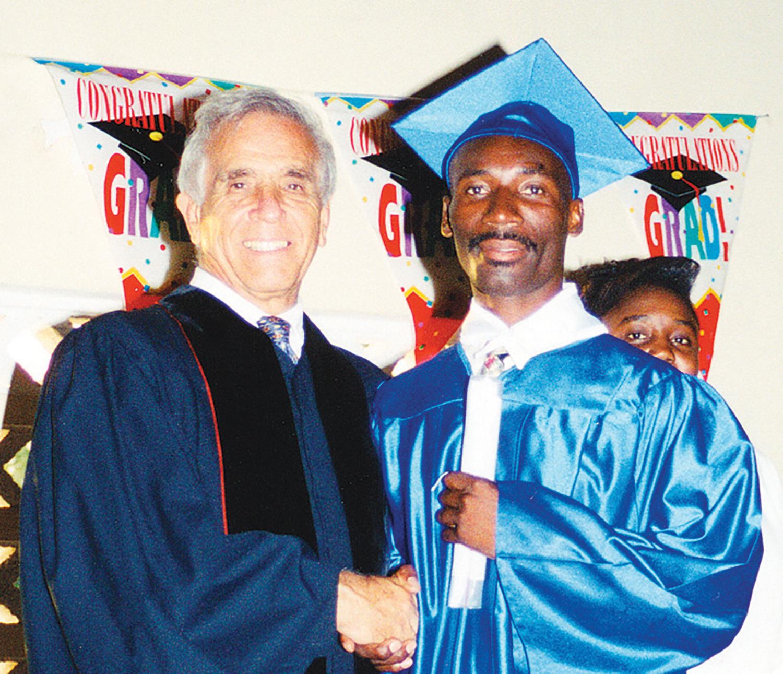 Pastor George DeTellis, Sr. with Pastor Joseph Elite Eliane (now pastor in Ti-Boucan, Haiti) on graduation day in the year 2000.