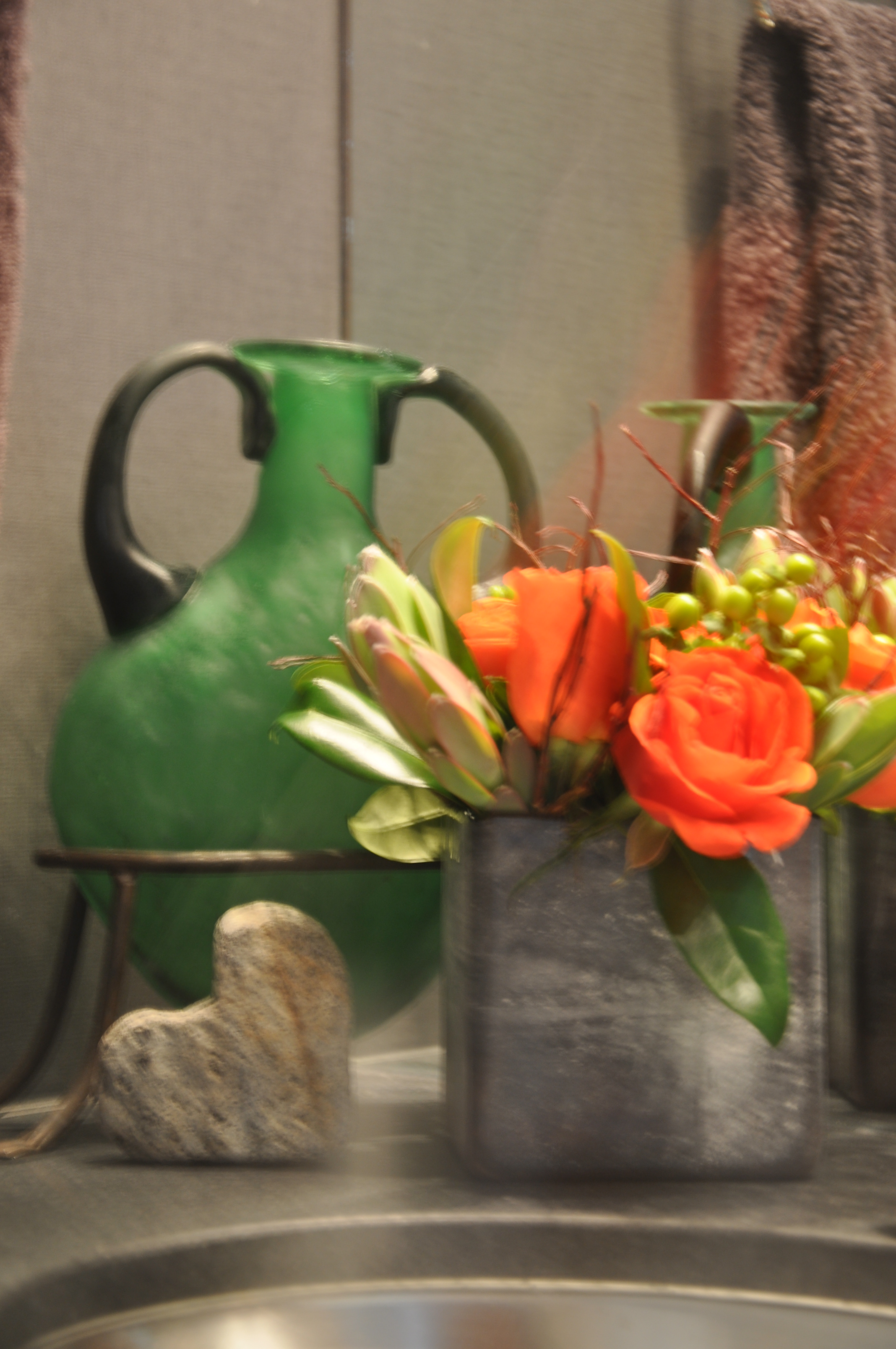 Powder Room: Fresh bright orange roses contrasting with bold charcoals