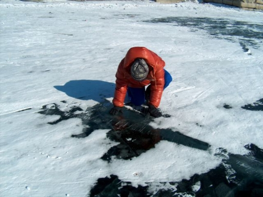 Staring down through ice which is 10 feet thick.