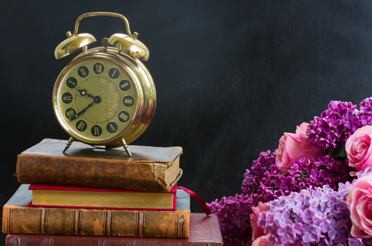 Blog.Pile of Books with Clock.png