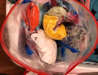 Pack individual camp outfits, including socks and underwear, in separate ziplocs. Then, roll the ziplocs and fit them all into one large 2-gallon ziploc labeled 'outfits'. Boom!