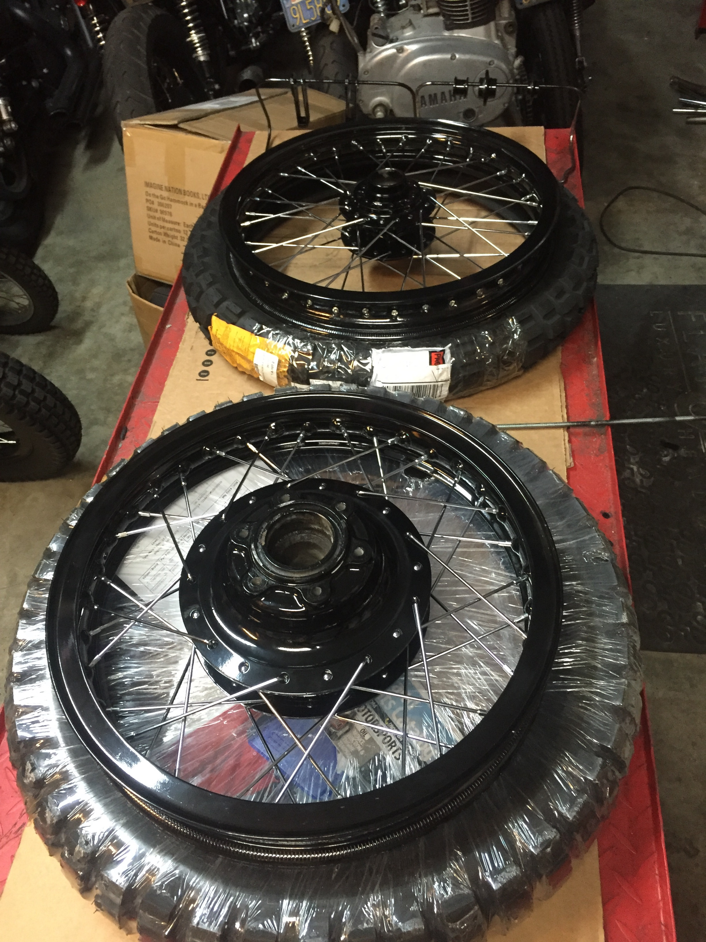 These TKC80 tires from Continental are gonna look mean!! We powder coated the hubs and wheels gloss black and laced them with new chrome spokes before wrapping them with these aggressive treads.
