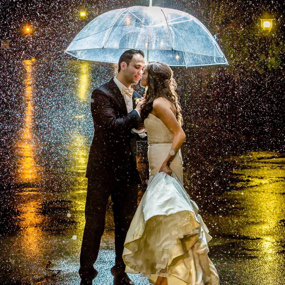 You might not buy into the old adage that a rainy wedding day brings good fortune, but you can't deny that often—with the right photographer behind the lens—Mother Nature styles some powerful photos. This one is cover-worthy, don't you think? Photograph by Hugo Juarez