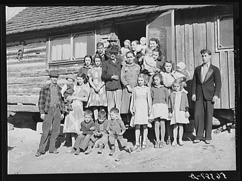 Noah Garland with his sons and some of their families. Southern Appalachian Project near Barbourville, Knox County, Kentucky, November 1940. Photographed by Marion Post Wolcott, courtesy U.S. Farm Security Administration.