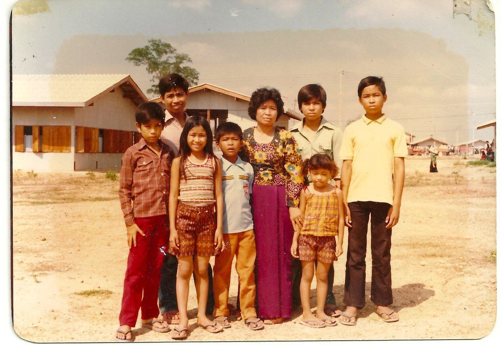 In a photograph from the new book  Buried  (Catfish Press, 2019; Vira Rama, Charles Fox), the Rama family at the Chonburi Transit Center, leaving their refugee camp in Thailand. Learn more below.