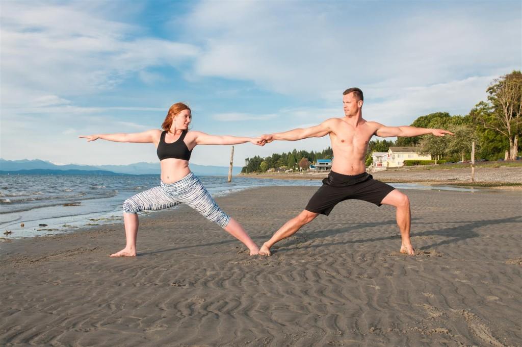 couples beach yoga