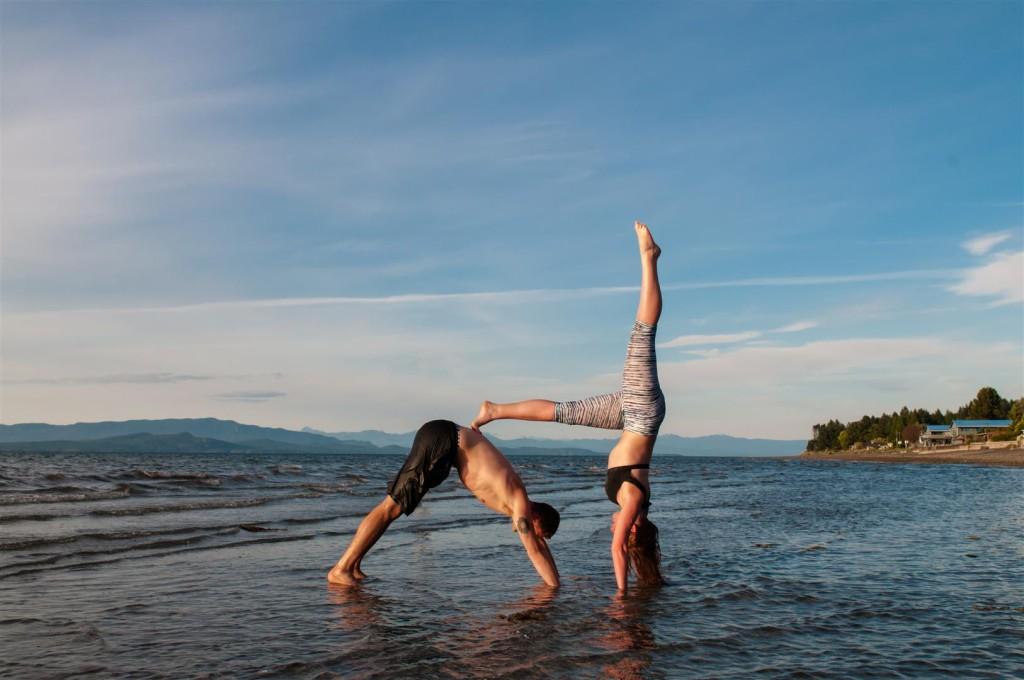 couples yoga beach