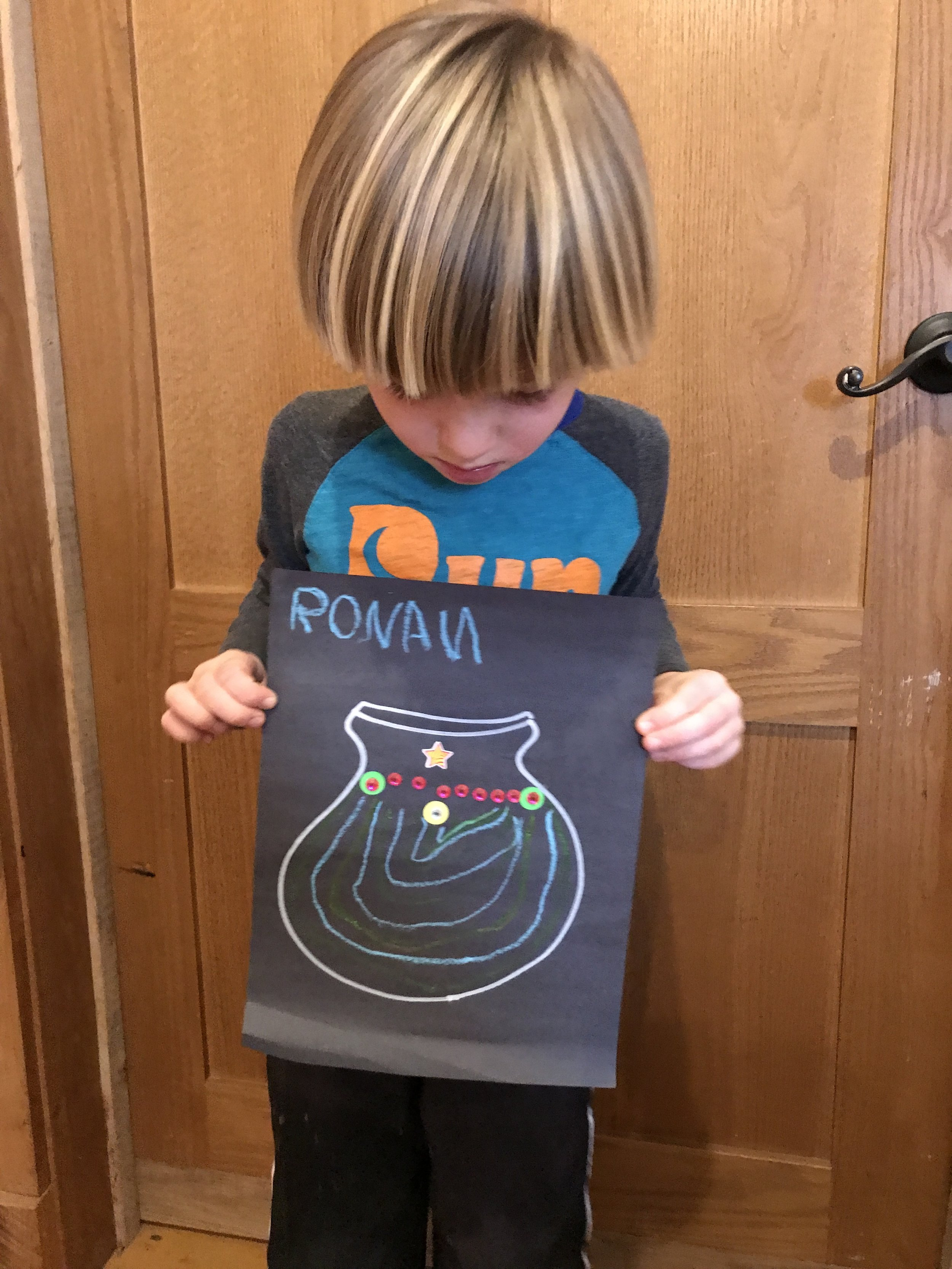 Ronan really enjoyed making his pattern. And I caught his picture before he stacked his pot in the cubby to take home. :)