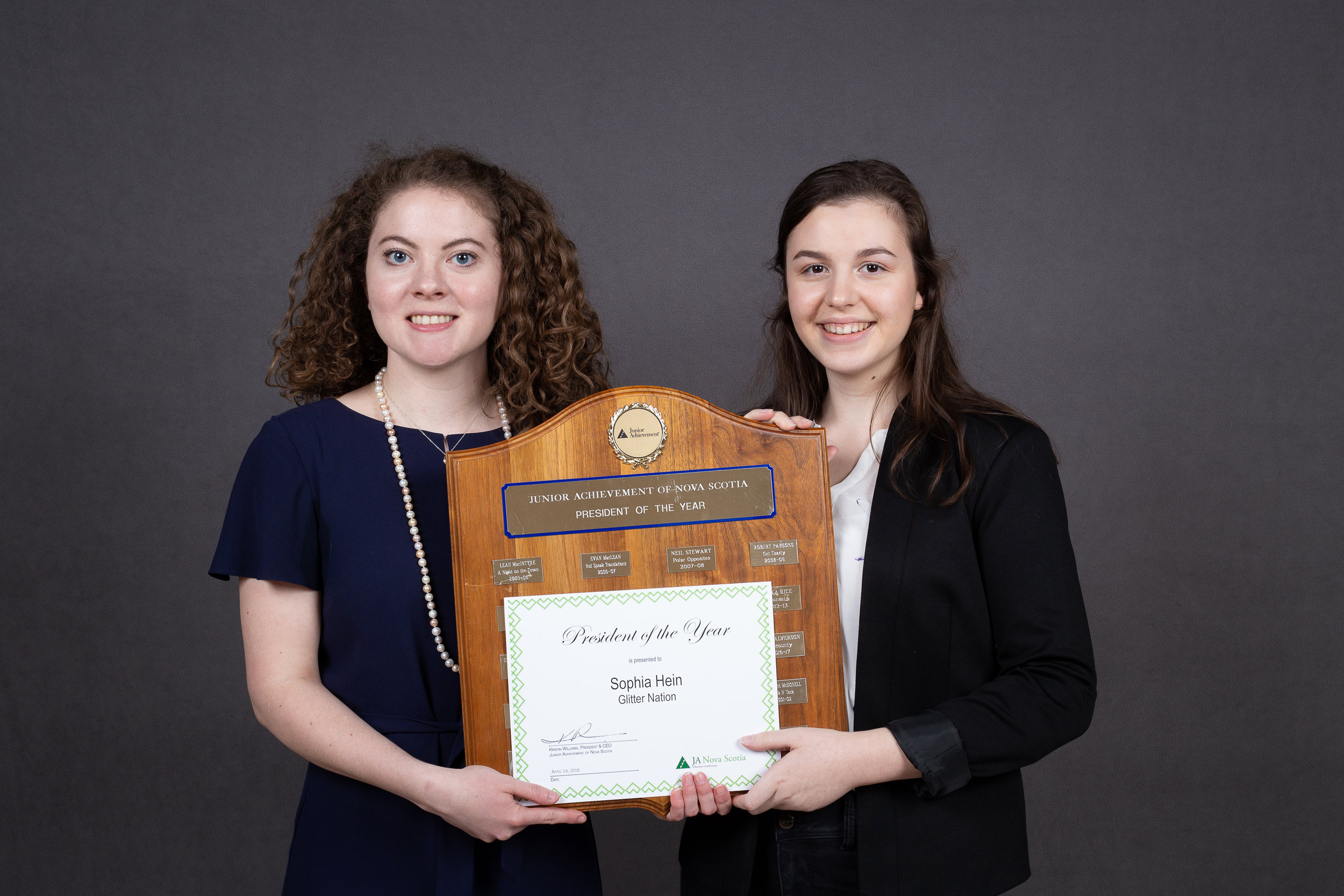 Stephanie (Left) pictured presenting the President of the Year Award which she won in 2013-2014 to the newest recipient, Sophia Hein (Right).