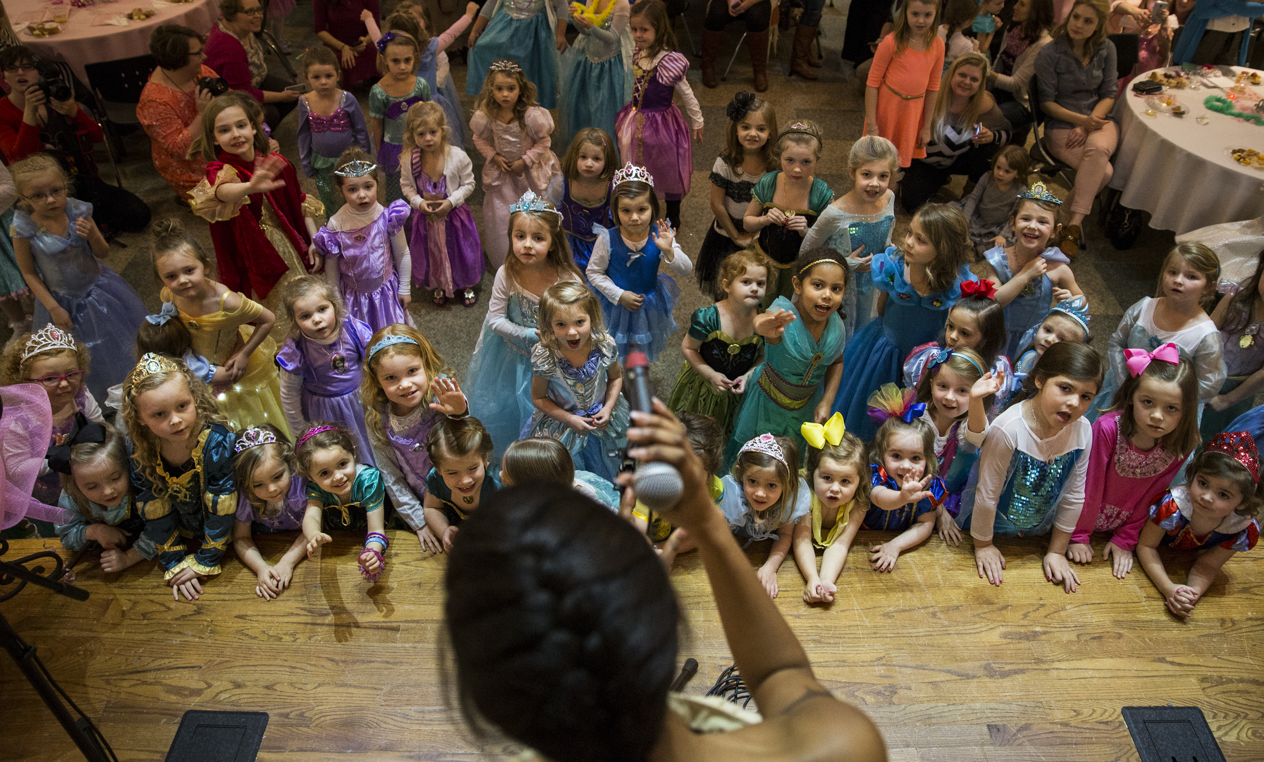 "In excitement, little princesses crowded the stage as Ryelee Robinson, dressed up as Pocahontas, sang ""Colors of the Wind,"" at Christ Episcopal Church on Sunday, February 21, 2016. This event was held by Bowling Green High School students to raise funds for the school's choral activities."