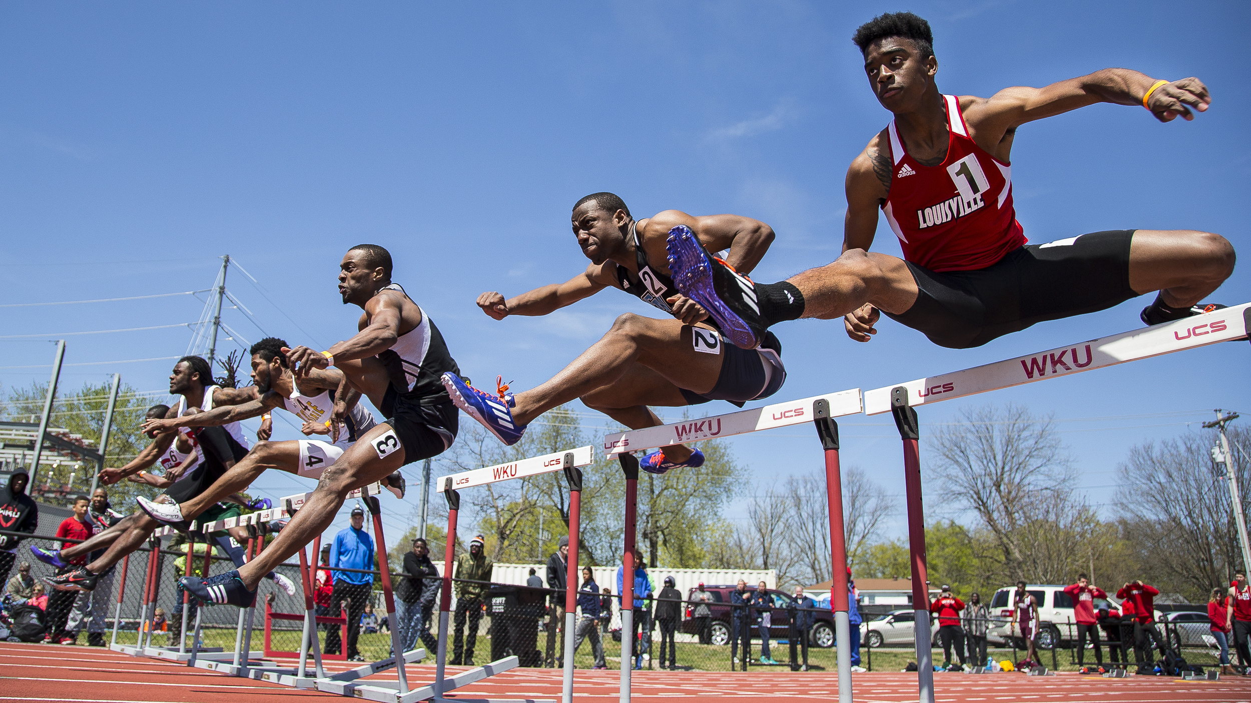 During the Men's 110 Meter Hurdles, Martice Moore, right, a freshman at University of Louisville, finished 6th with the time of 14.49 seconds at the Hilltopper Relay Meet at Charles M. Rueter Track and Field Complex on Saturday, April 9, 2016.
