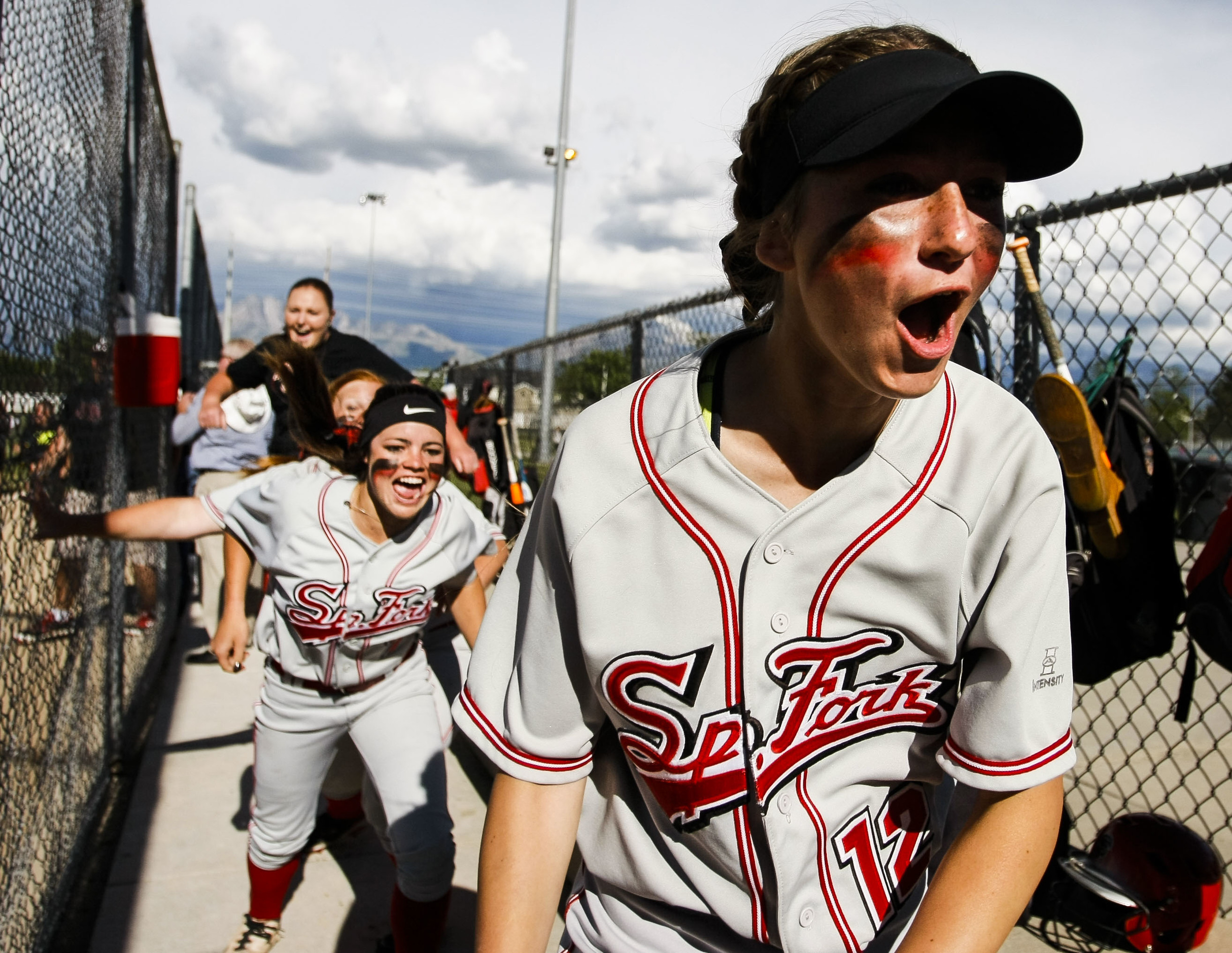Spanish Fork's Morgan Scott, right, rushes the field during the 4A softball championship game against the Maple Mountain Golden Eagles in Taylorsville, Utah, on Thursday, May 26, 2016. The Spanish Forks beat Maple Mountain 5-2.