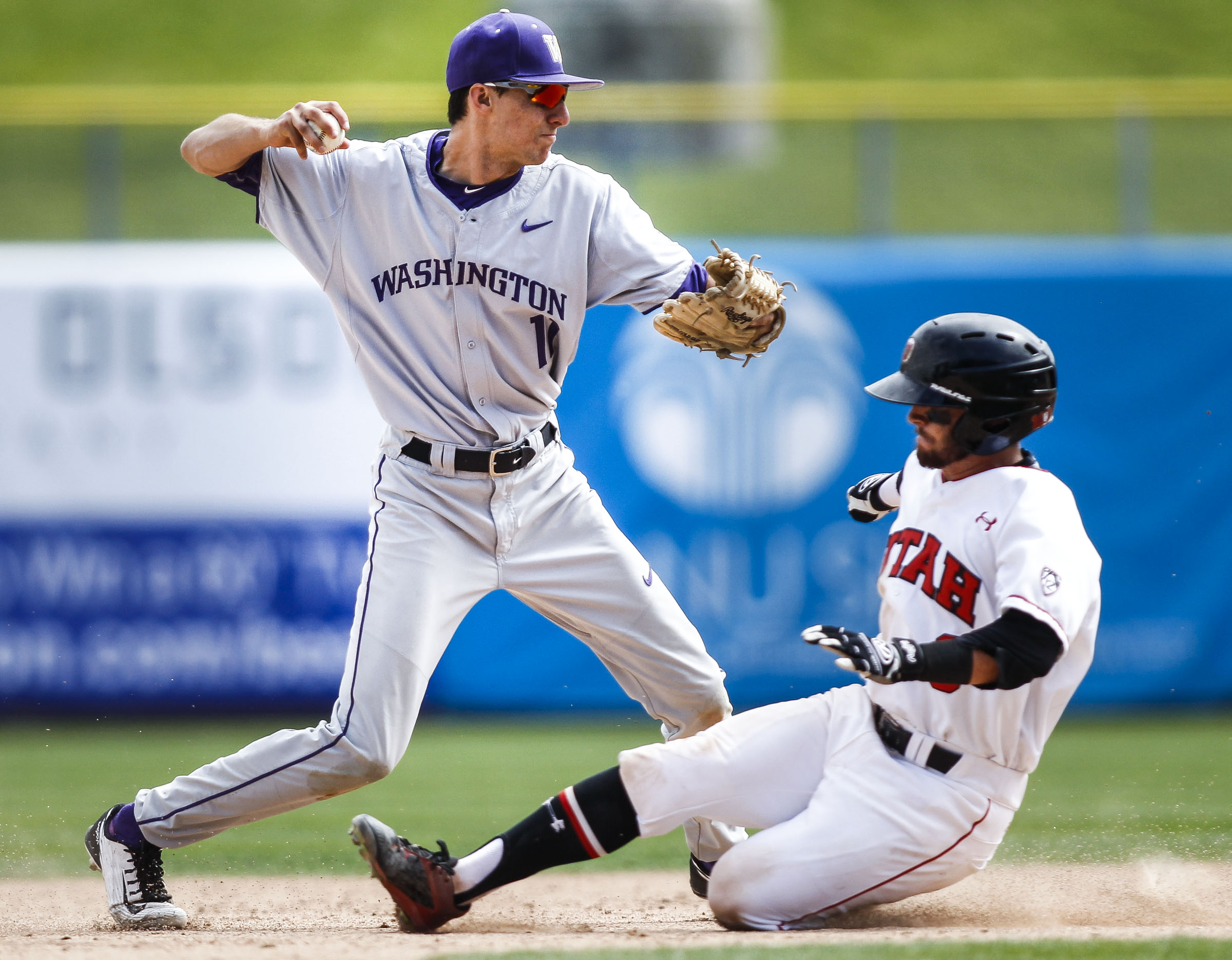 Washington Huskies AJ Graffanino (11) throws the ball to first base causing two outs in one play during the Pac-12 baseball championship three-game series against the Utah Utes at Smith's Ballpark in Salt Lake City, Friday, May 27, 2016. The Huskies defeated the Utes 5-4.