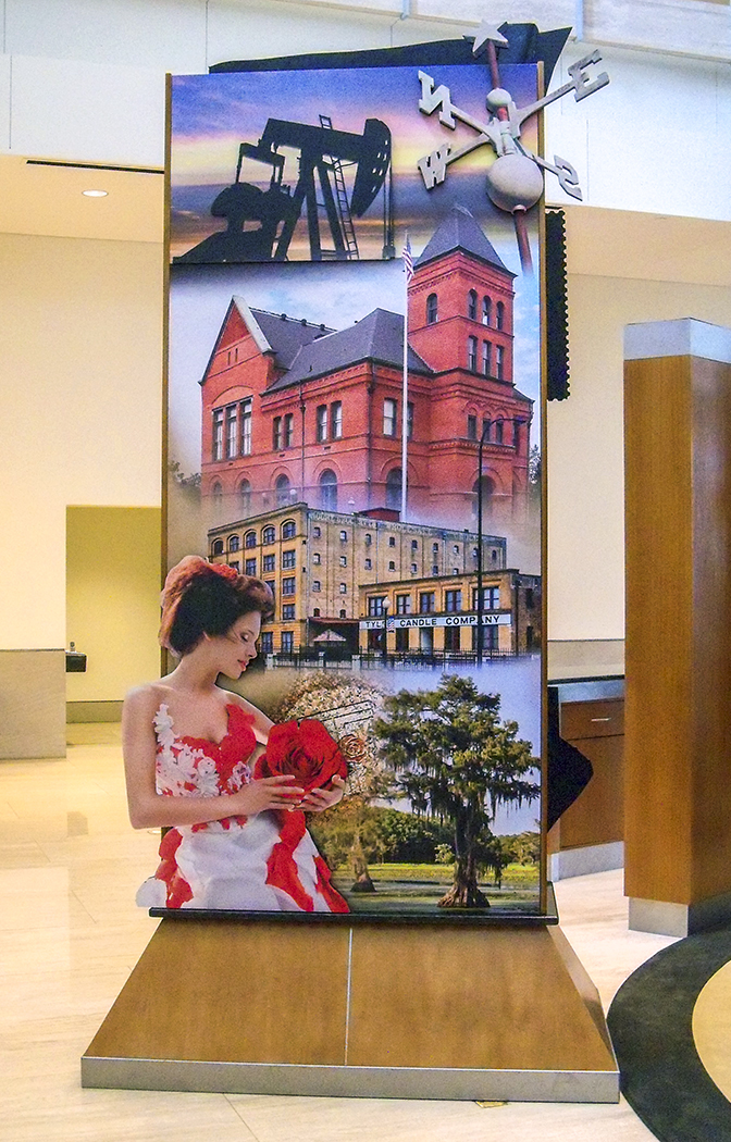 """""""Pylon Design"""" • Exhibit lobby of the Federal Reserve Bank of Dallas.  4' by 9' pylon has stand-off embellishments. Depicting prominent images from the surrounding region of South Eastern Texas. © KT"""