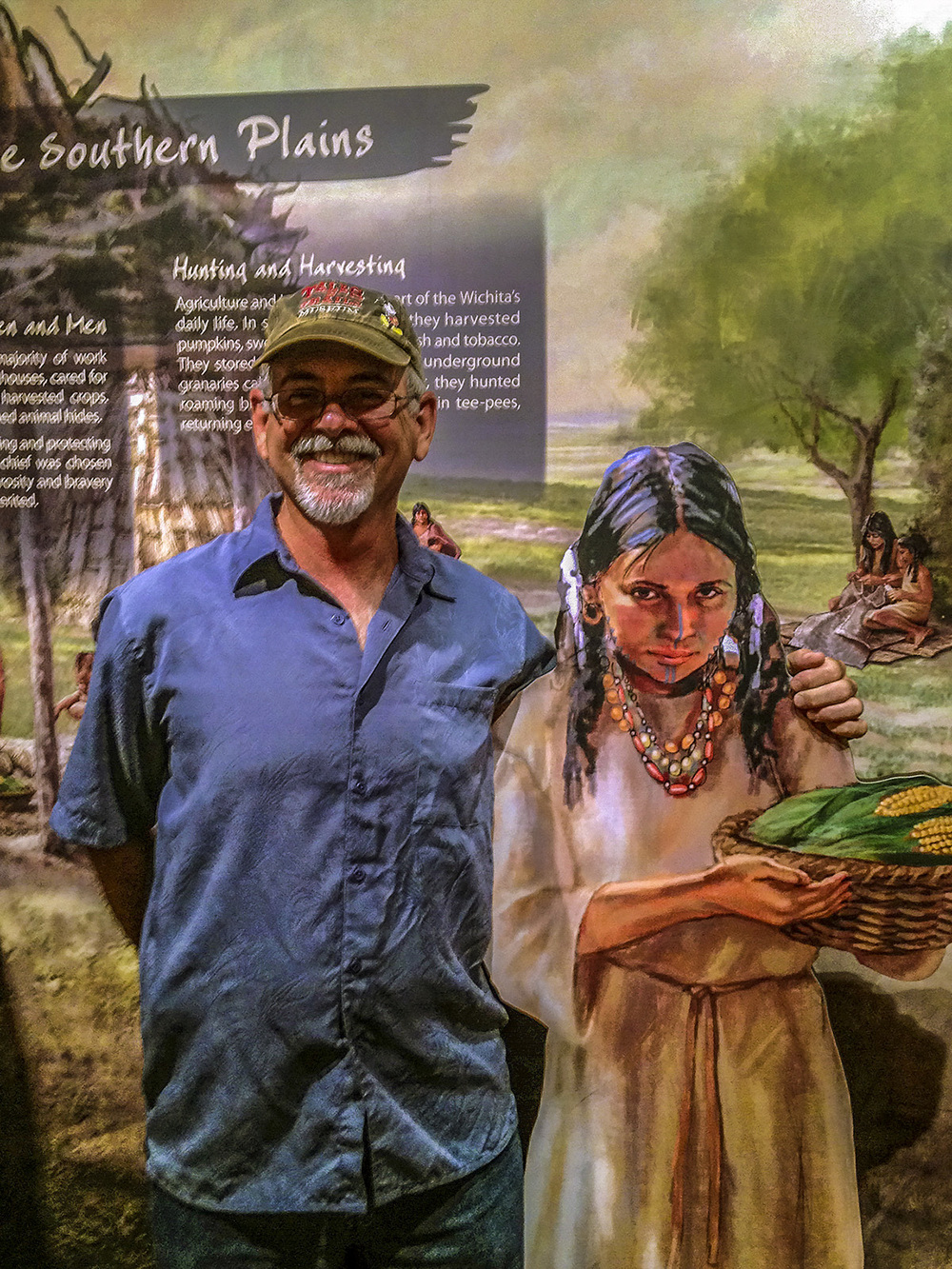 """""""Native girl"""" • This visitor shares a smile with the Witchita Life mural stand-off • Tales N' Trails Museum, Nocona, TX. © KT"""