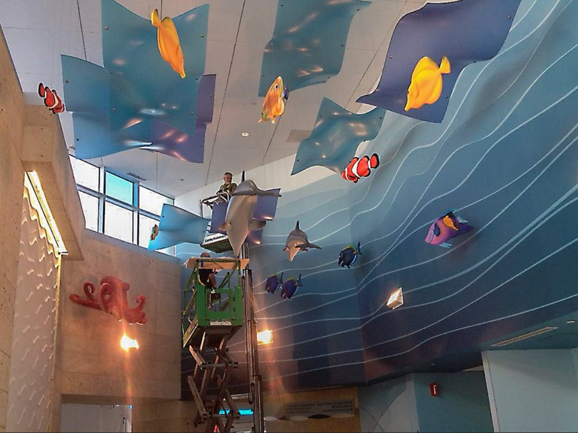 University Health Systems, Children's Hospital – Pitt County Memorial Hospital. Installation of the sculpted sea creatures. Main lobby of the Children's Hospital..