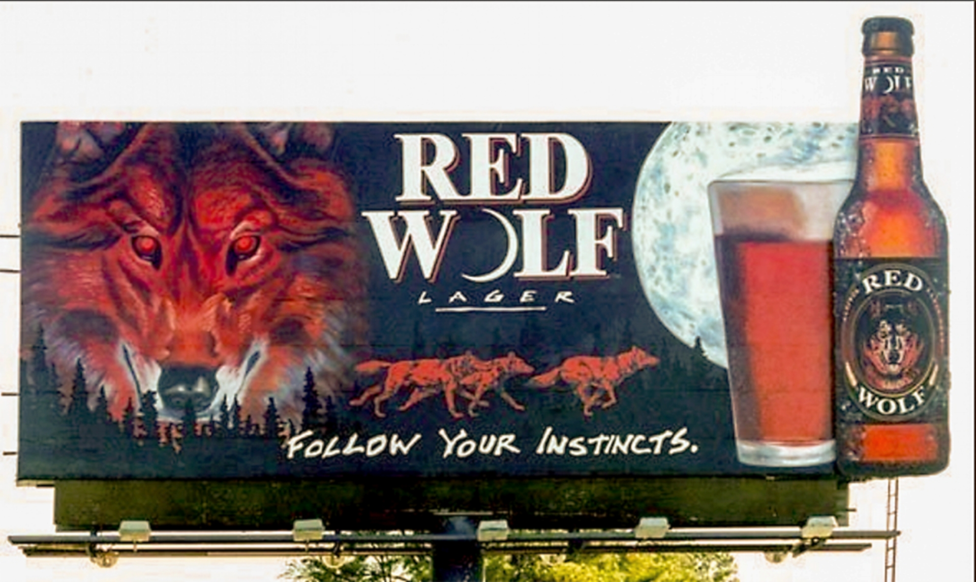 """Outdoor Advertising- """"Follow Your Instincts"""" • Red Wolf Lager. 14' by 48' billboard, hand painted in bulletin enamel.. © KT"""