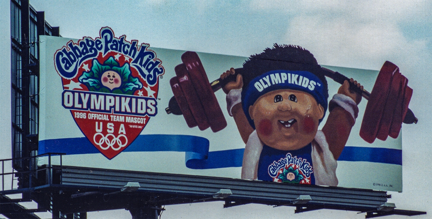 """Outdoor Advertising- """"Olympikids"""" • Cabbage Patch Kids. Handpainted this 14' by 48' billboard. © KT"""