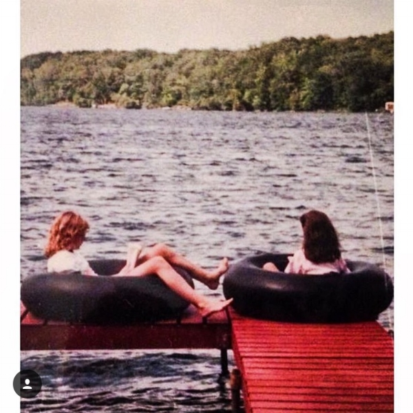 My cousin and I reading on the dock at the cabin.