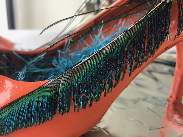 I started by gluing peacock feathers on the sides of shoes.