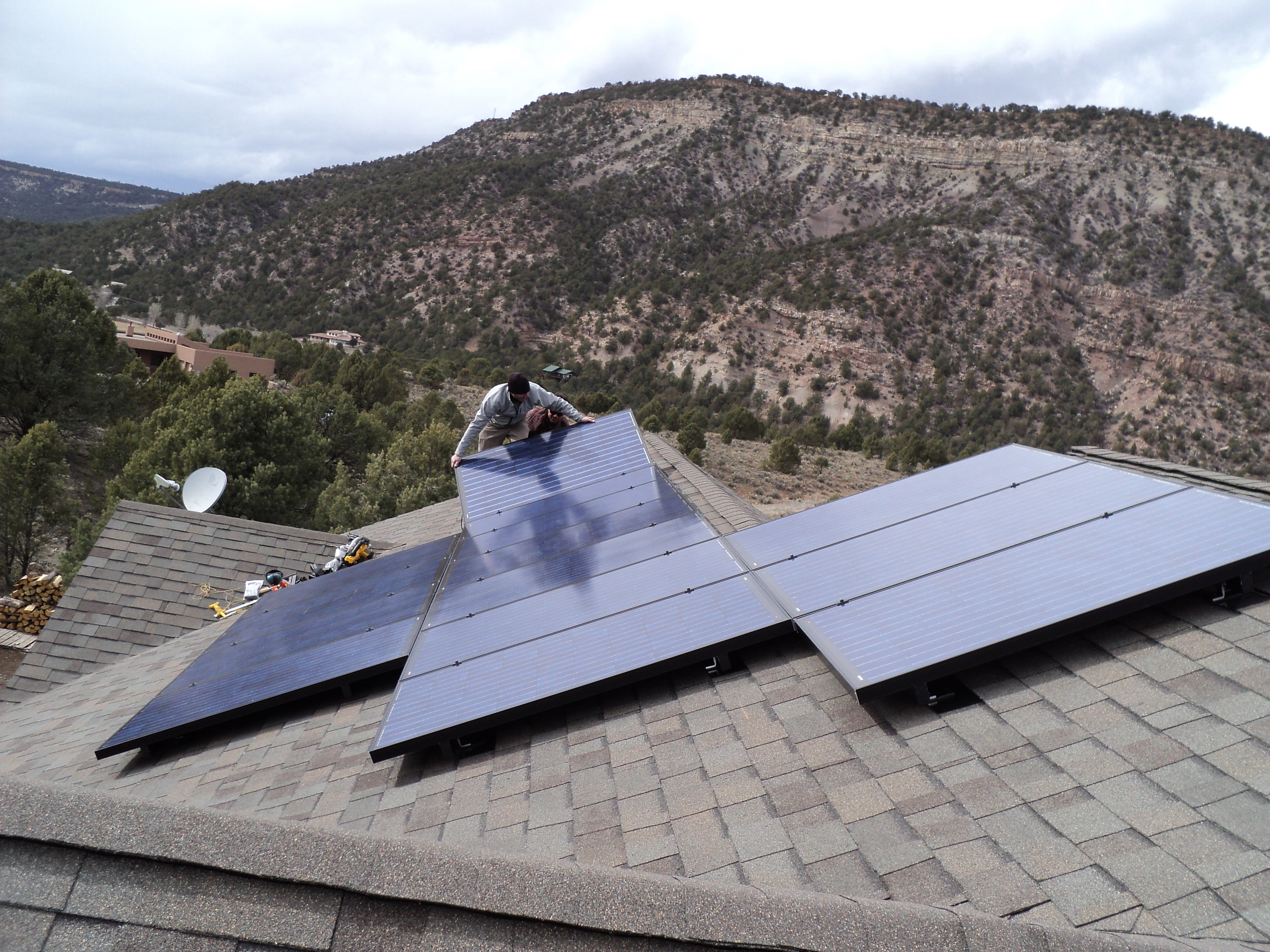 Alternative Power Enterprises employee installing a solar power system on a roof in Western Colorado