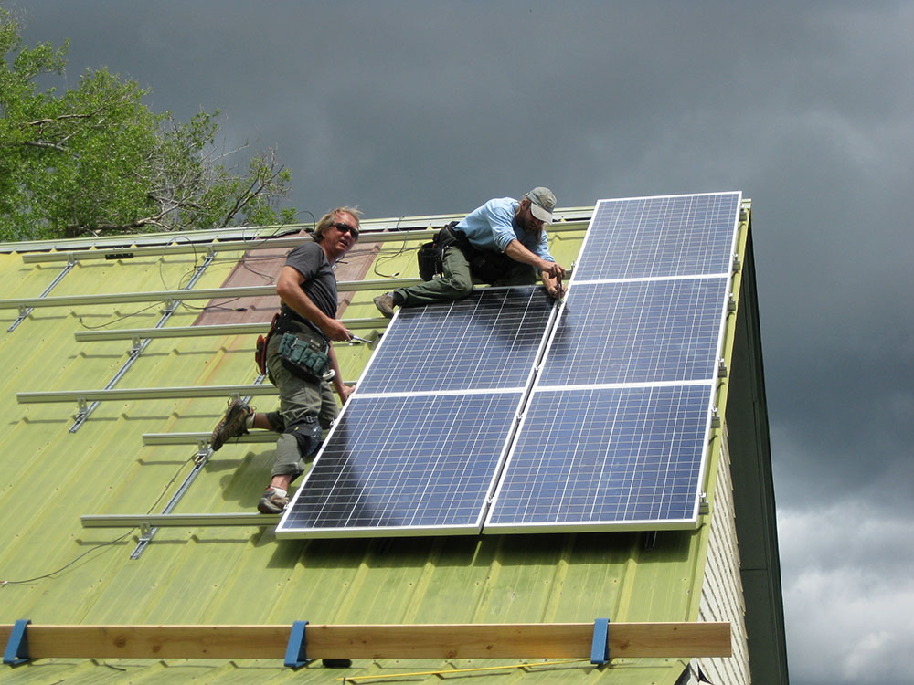 Alternative Power Enterprises employees preforming maintenance on a solar power system in Western Colorado
