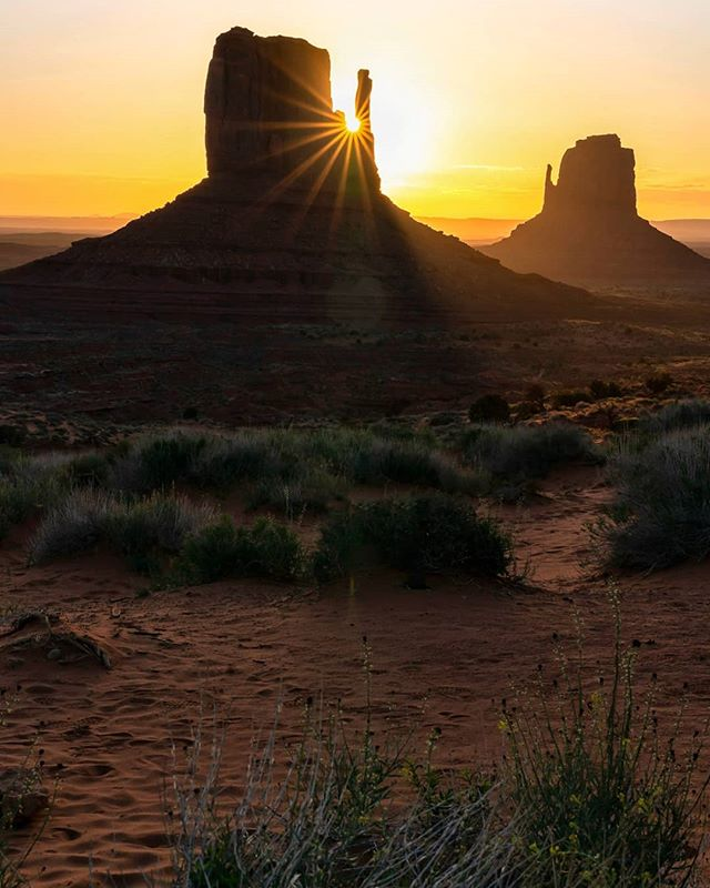 "MV is a clutch spot to always get a breathtaking sunrise. I caught this brilliant sunburst on Earth Day in Monument Valley a few days ago. Being blessed enough to wake up to a view like this was a great reminder of just how alive this amazing planet is and how connected we all are to the universe. -  This weekend we were able to see some of the most iconic views in the Southwest in only 3 days.. shooting a gorgeous full moon all night and never wanting to miss a single sunrise, I'd  say I averaged about 2 hours of sleep a night, so it was more like naps you could say, but well worth it! -  Side note, our ""friend"" the sun here is going to swell into a red giant and engulf the earth and erase human existence in about 5 billion years 😲 but my bet is on mankind ending our existence long before the sun ever does. The question is, what are we doing every day so that we can go out like a rock star engulfed in flames instead of drowning in our own filth? Lol #Utahtravels #MonumentValley #Utah"