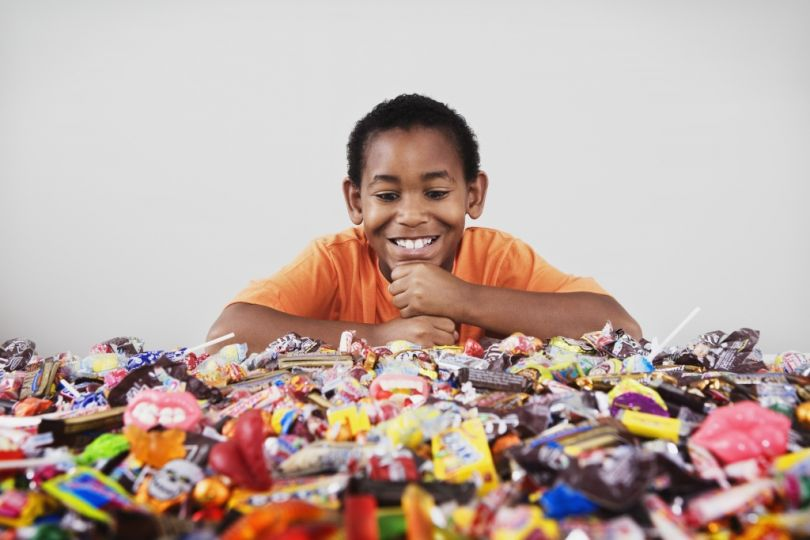 Does anyone think this kid is not going to not ALL the candy?