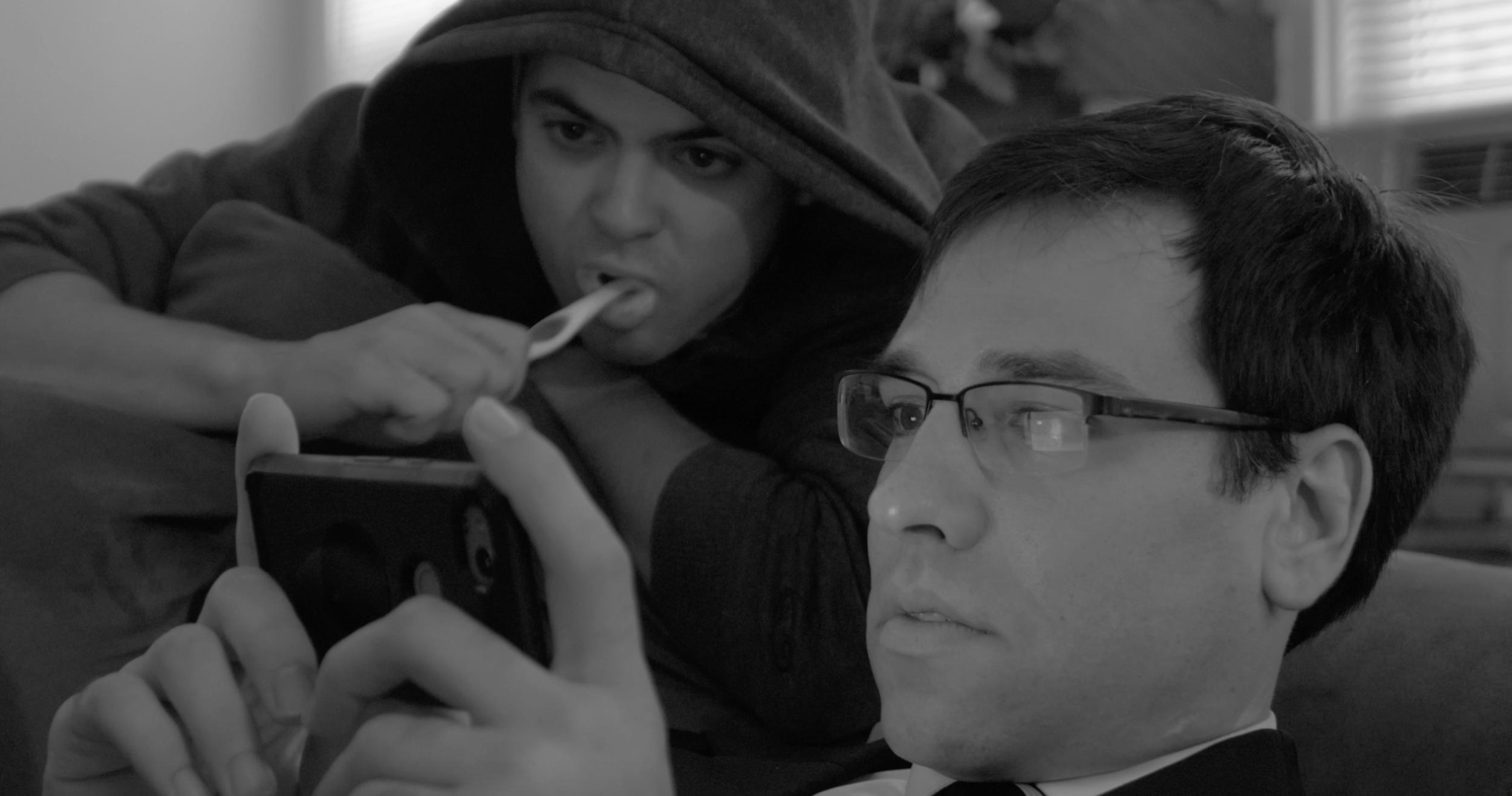 Reese + Erick watching.png