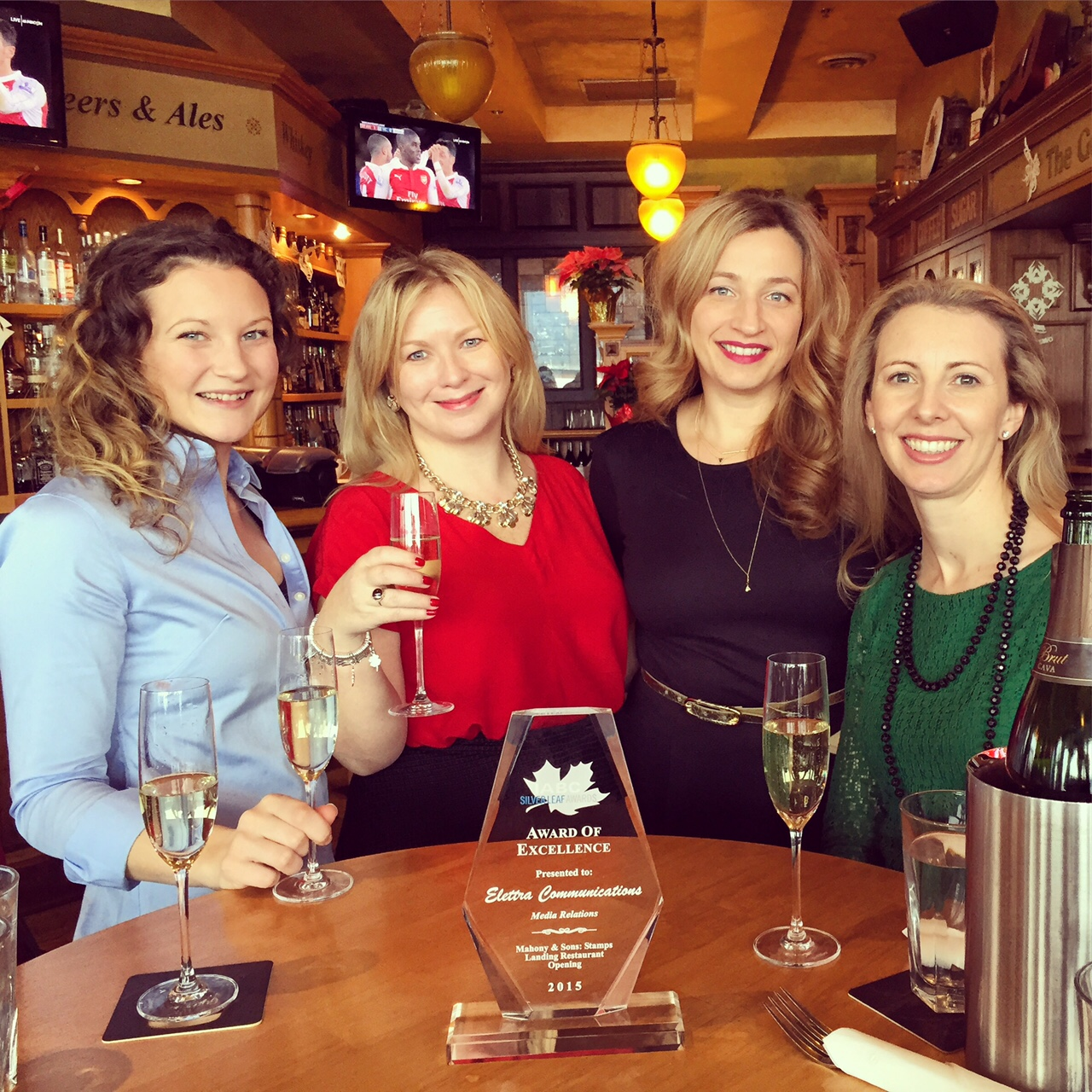 The Elettra team toasting our IABC Silver Lead Award of Excellence for Media Relations.