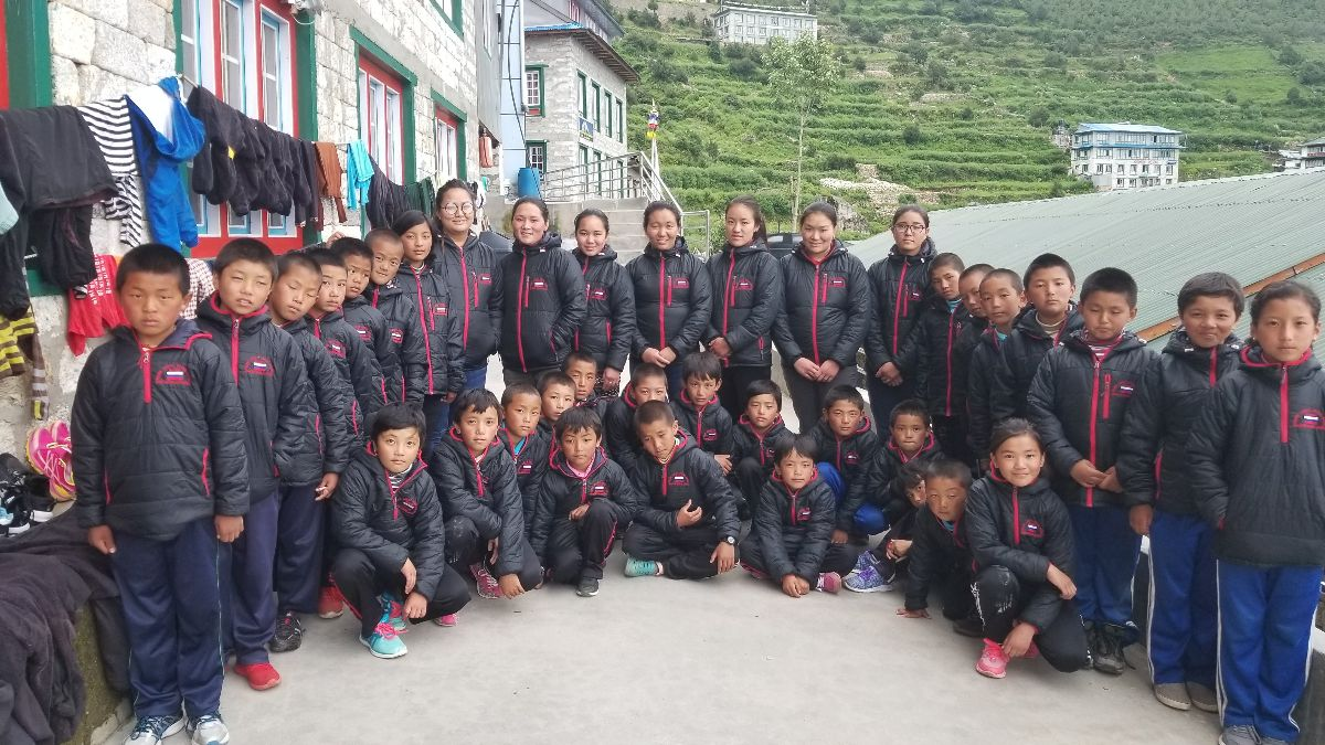 Students at the Shree Himalaya School in Namche Bazaar proudly wearing their new jackets