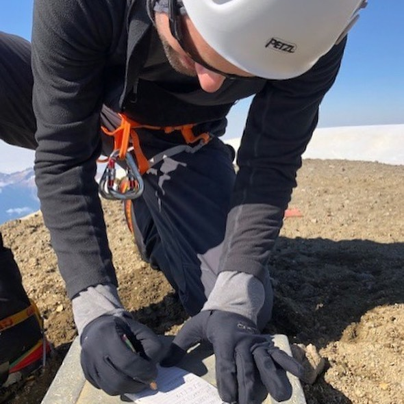 "Grayson Dill signs the Mt Baker summit register with ""Alpine Ascents Foundation 1st Charity Climb"" thank you Grayson for climbing with us on our first charity climb!! #alpineascentsfoundation #alpineascentsinternational #sherpaeducationfund #mtbaker #charityclimb"