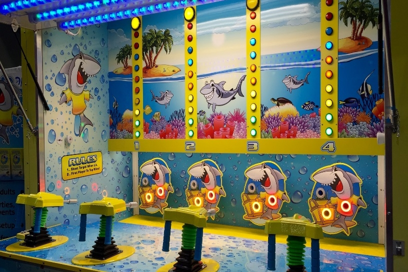 Test your aiming skills with an exciting twist! Players will have to shoot the water through whichever area is being lit up by the LED colors! Who will be the winner? That's for you to decide!   People Per Hour: 100+   Power Requirement: 20 AMP   Set-up Time: 1 Hour Space Required: 15' X 15'