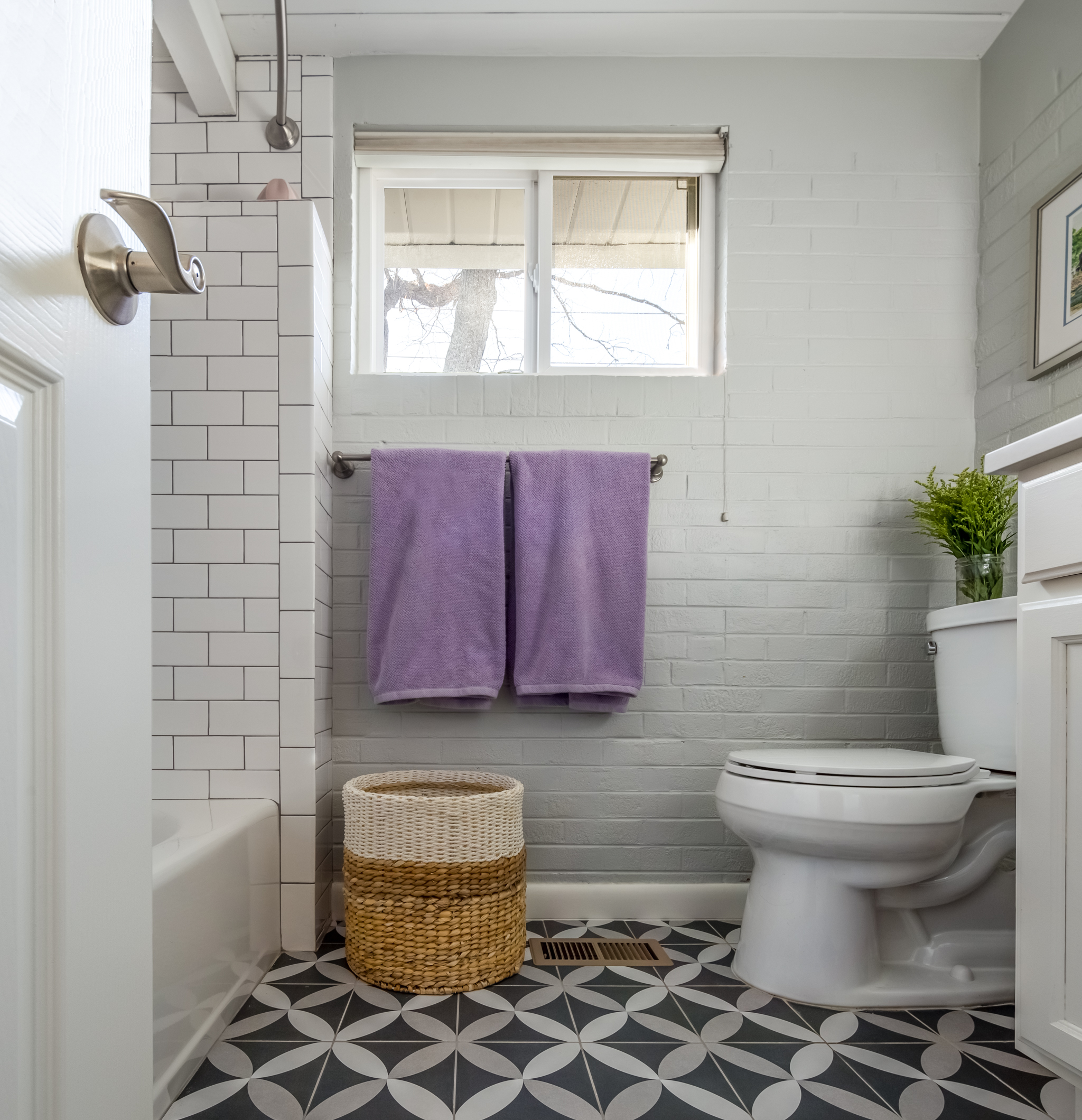 We updated the tile and paint in this bathroom off of the family room.  Sometimes, that's all you need to do to update the look!