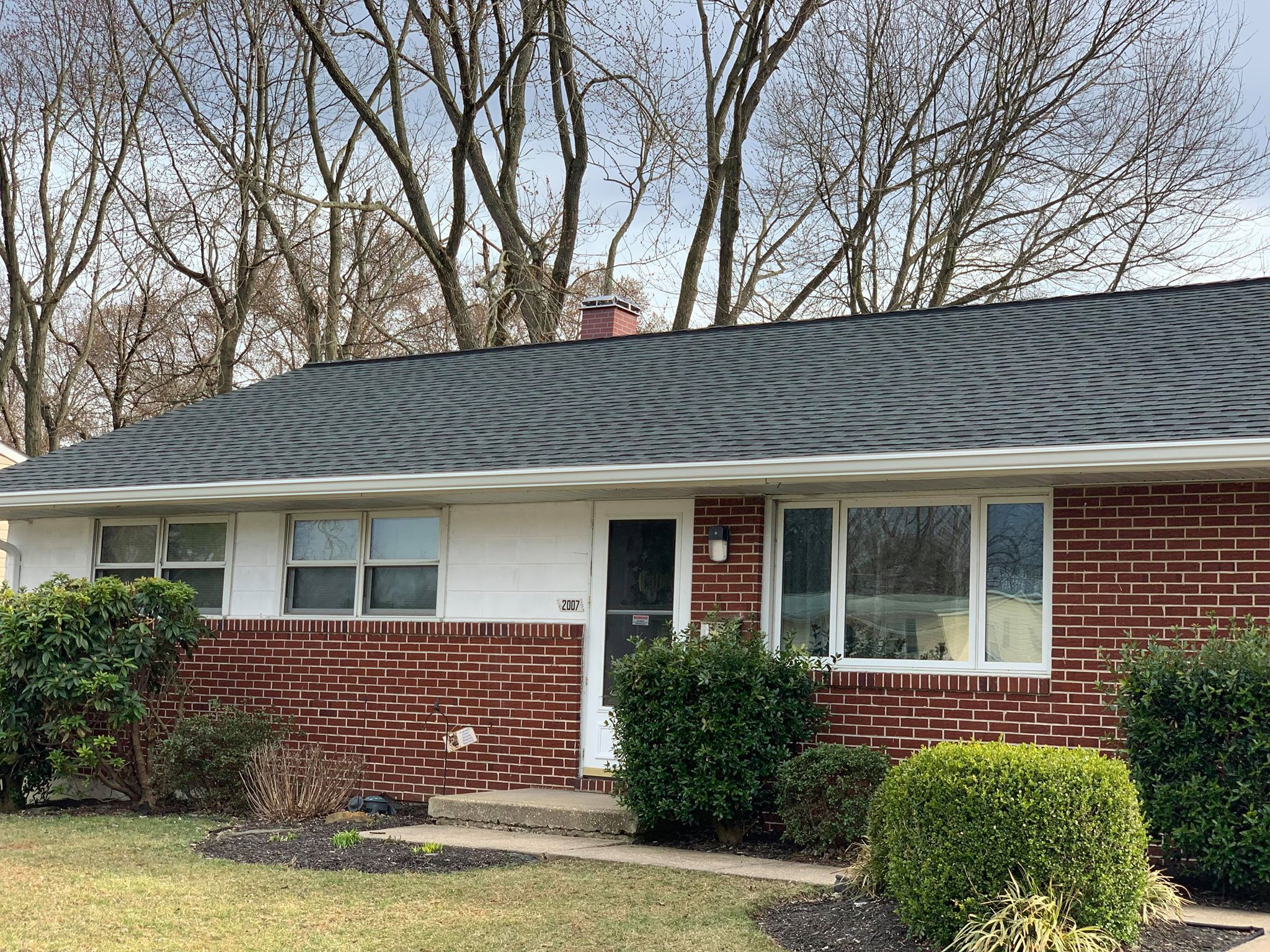 The O'Hara Family Home - a fresh, new charcoal roof and gutters system!